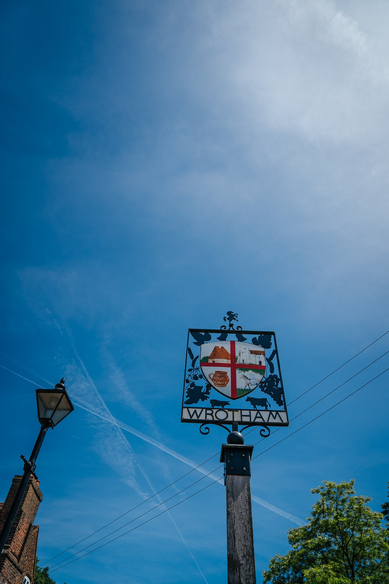 Bright blue sky behind Wrotham village sign on wedding morning