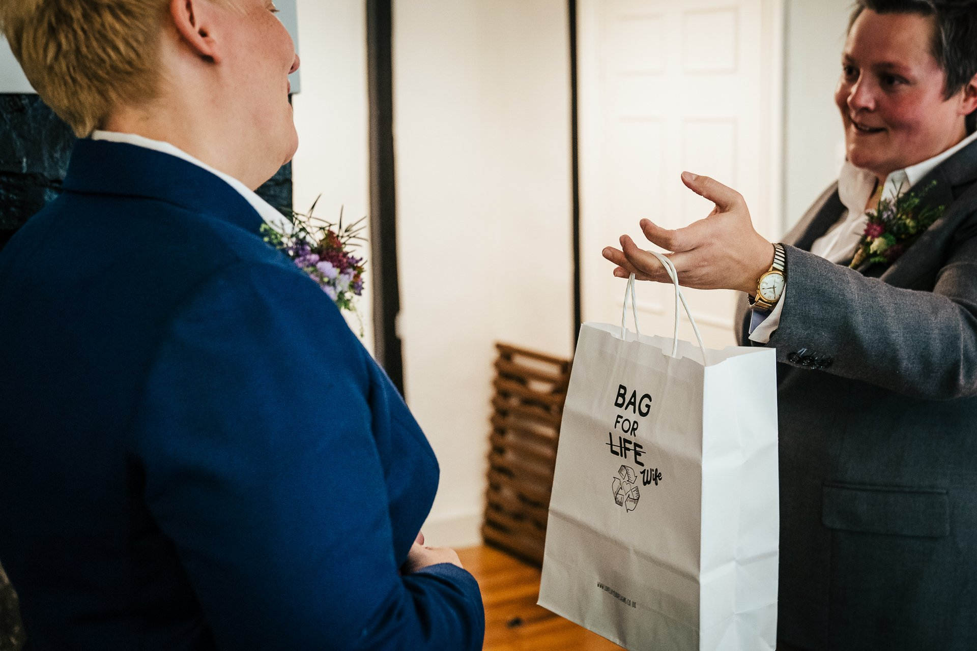 Two brides exchange gifts before their wedding