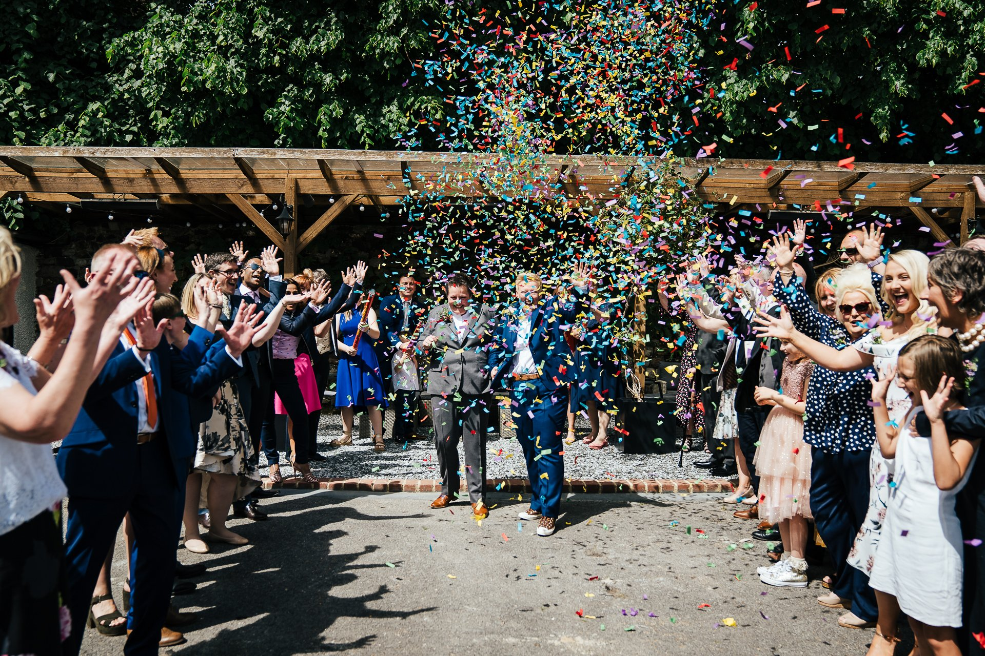 Two brides showered with confetti after their wedding ceremony