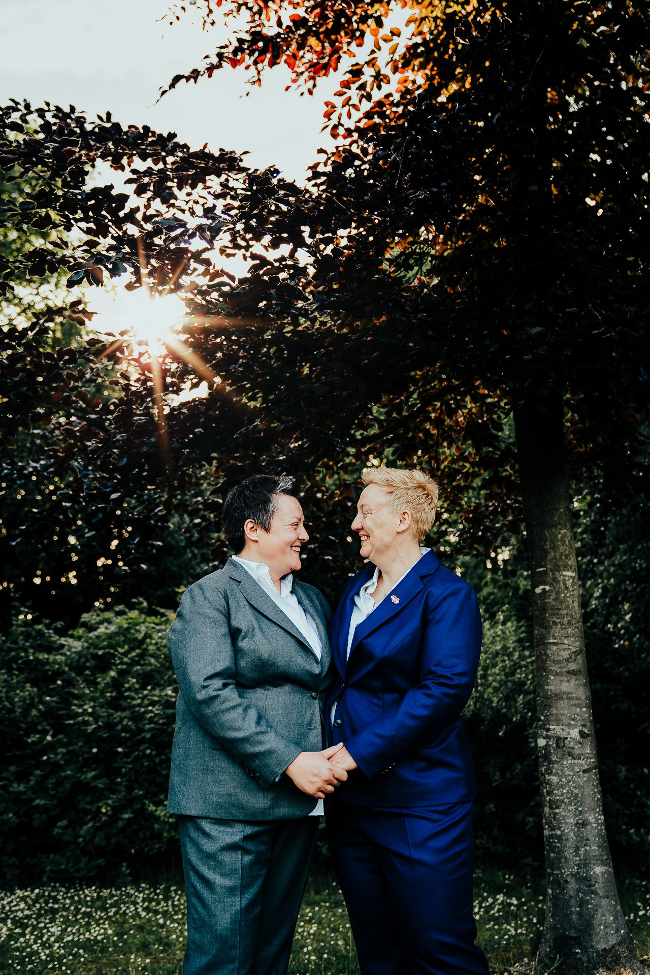 Newly wed couple holding hands during golden hour portraits