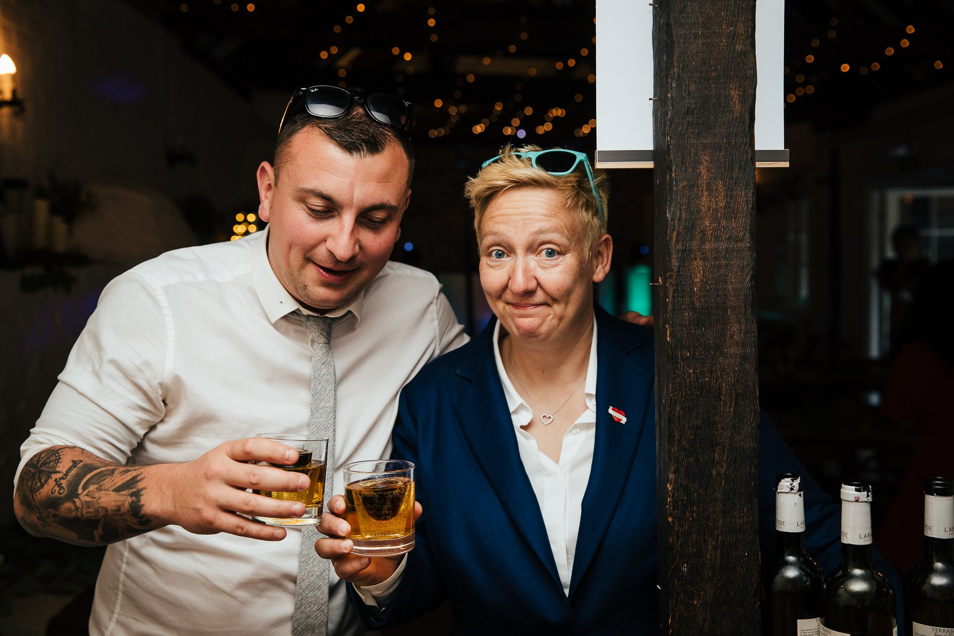 Couple raising a toast during wedding reception at The Bull