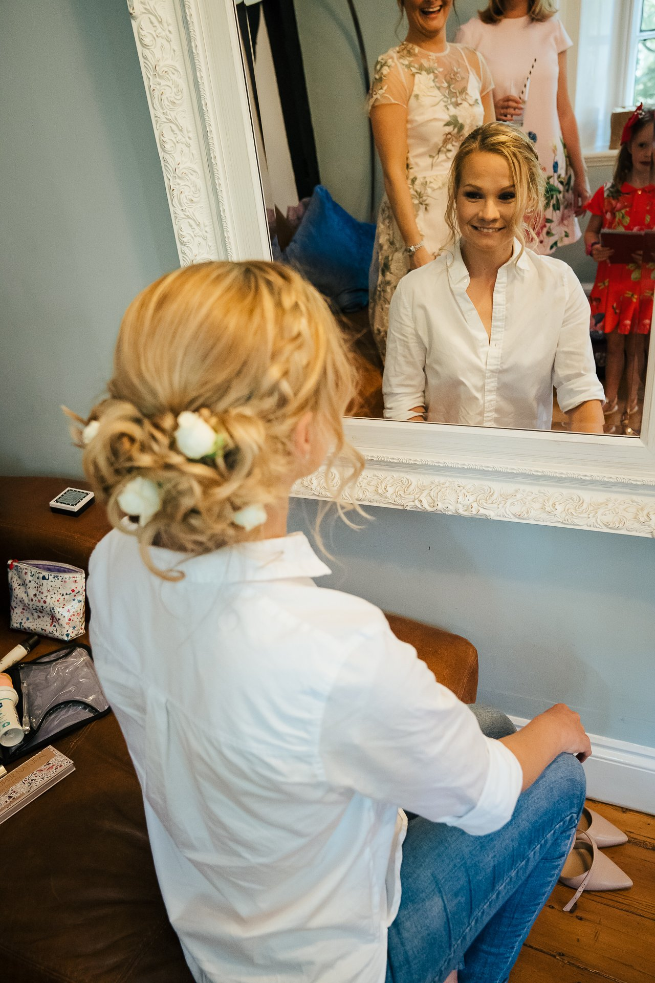 Beautiful Bridal hair with white flowers in the bridal suite at The Bull Wrotham