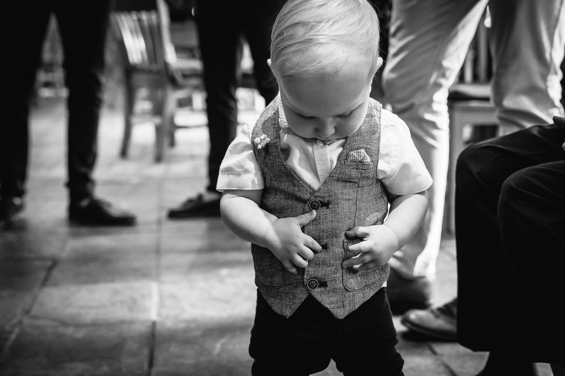Toddler in his wedding waistcoat before the wedding