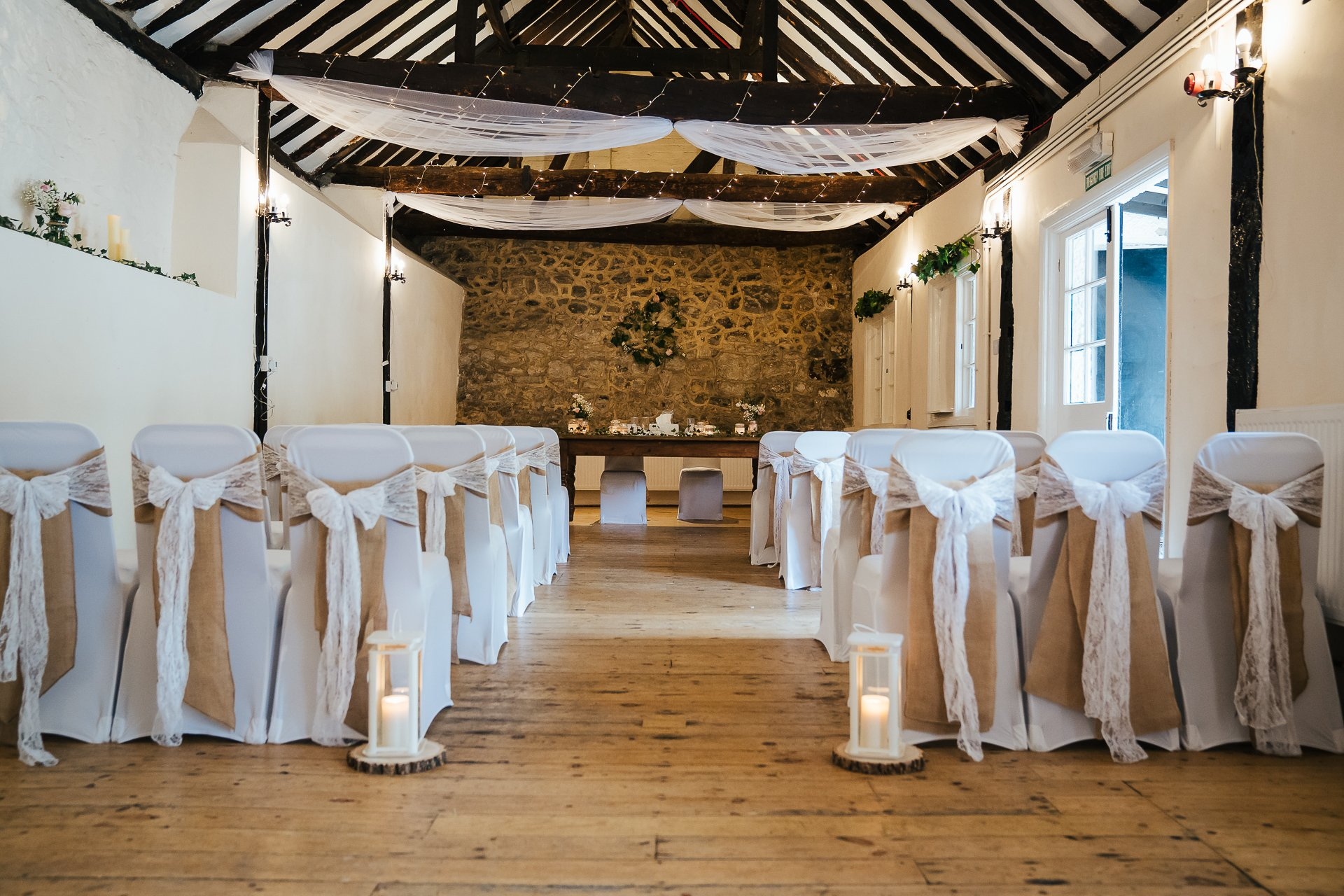 The Buttery at The Bull Hotel decorated for a rustic wedding ceremony