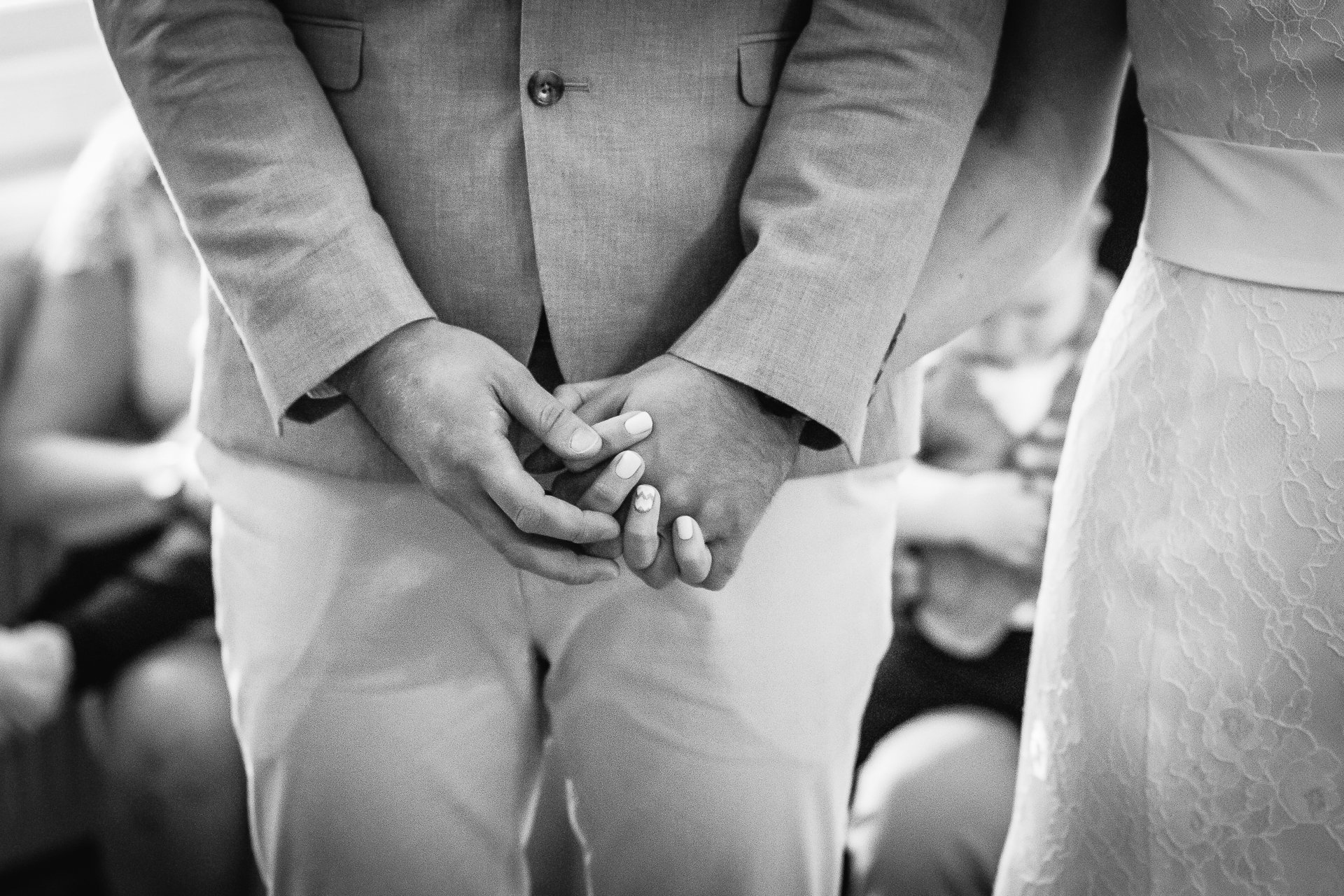 Bridal couple holding hands during their ceremony