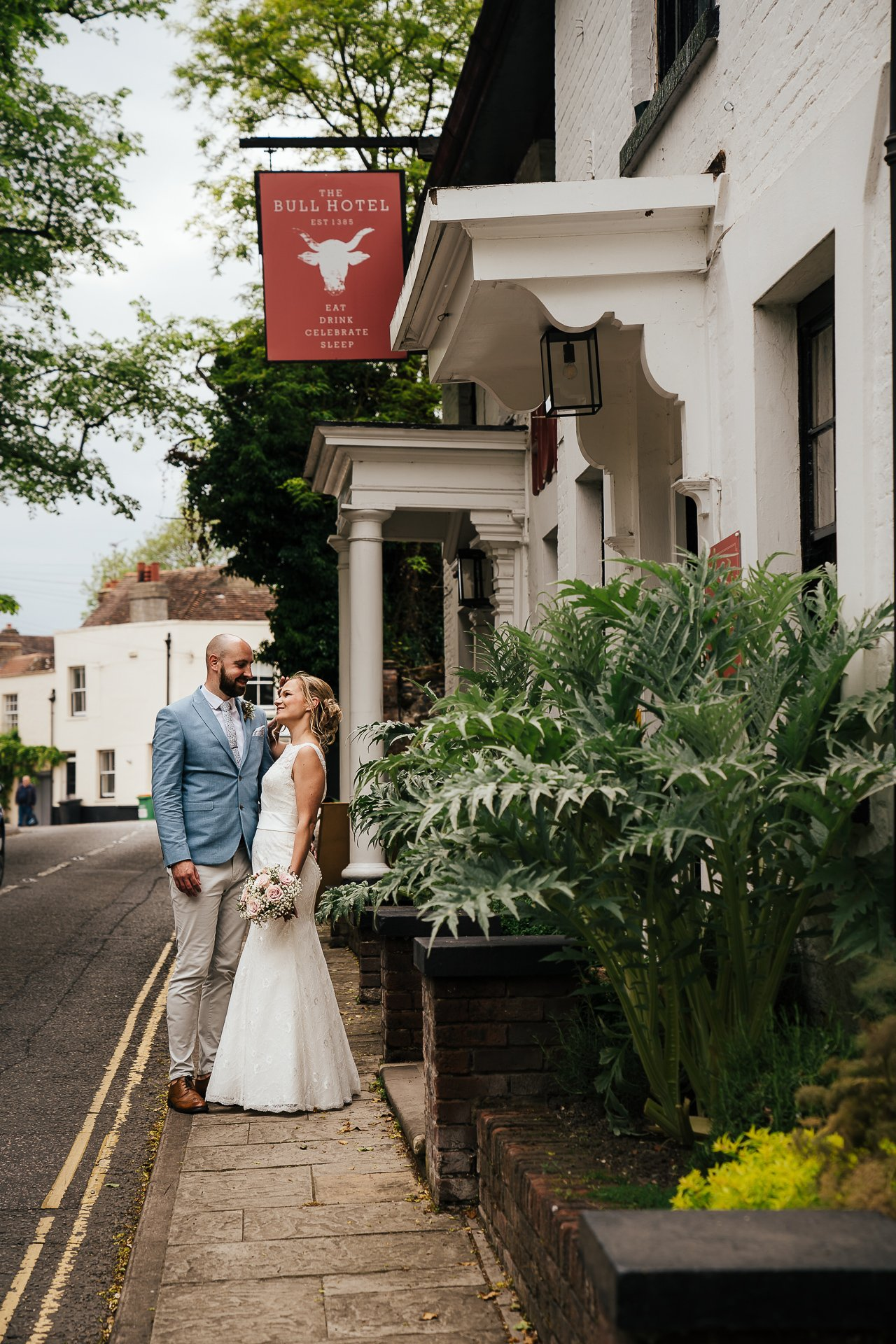 Newly wed couple outside The Bull Hotel, Kent Wedding Venue