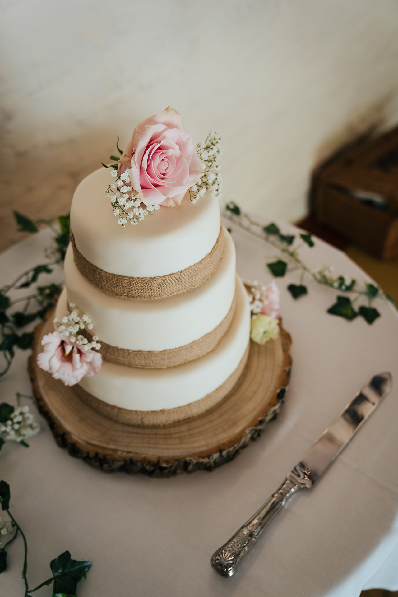 Beautiful rustic wedding cake with pink roses at The Bull Wrotham