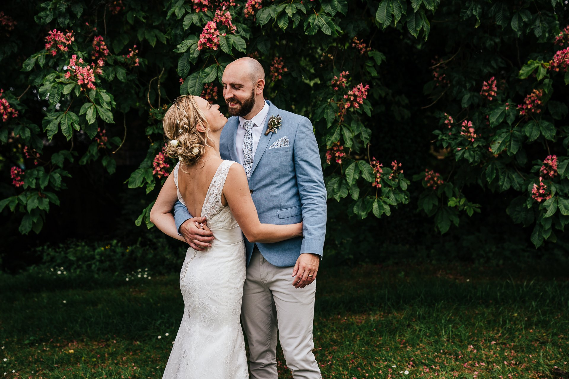 Newly wed couple embracing during bridal portraits
