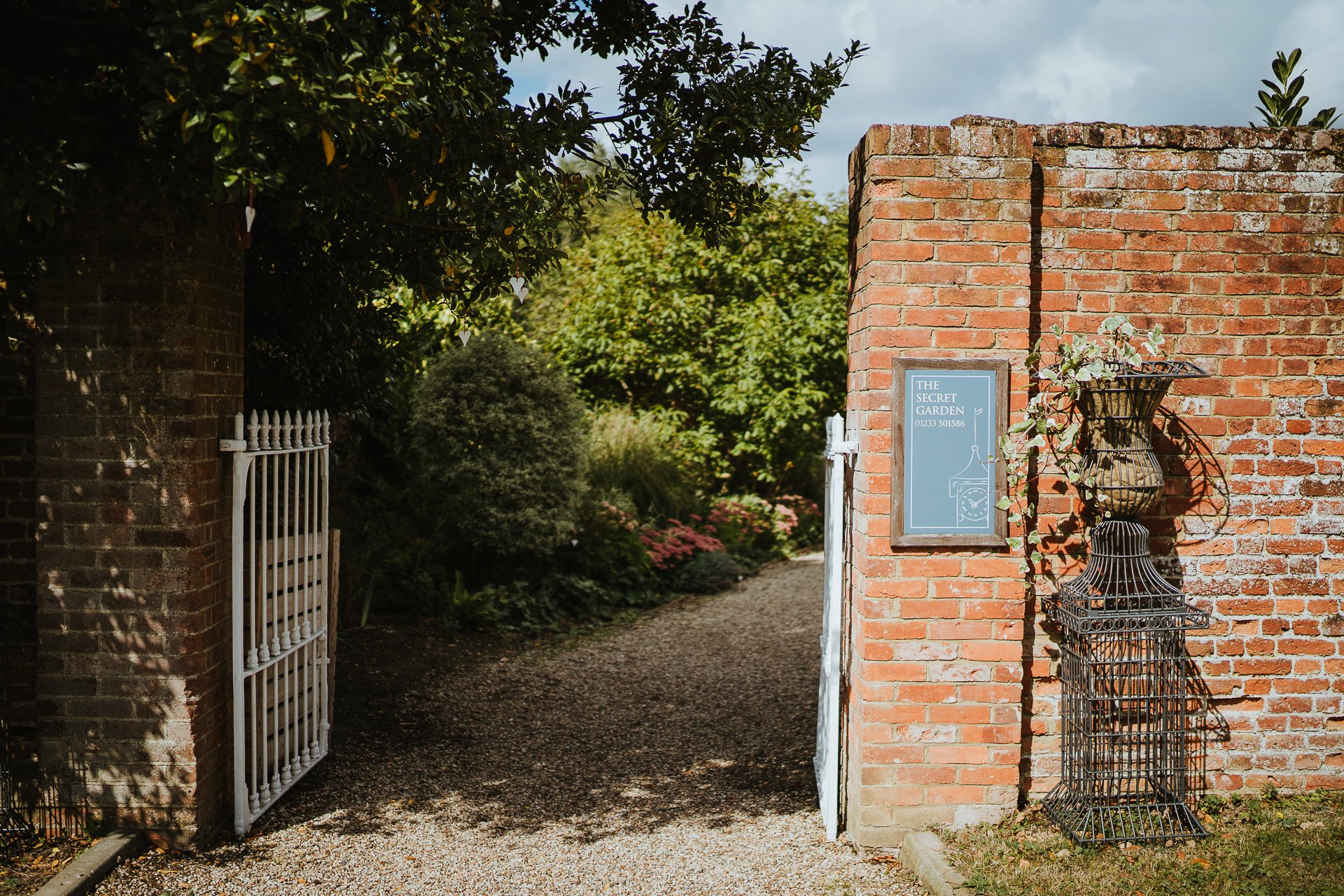 Open entrance gate to The Secret Garden Wedding venue in Kent