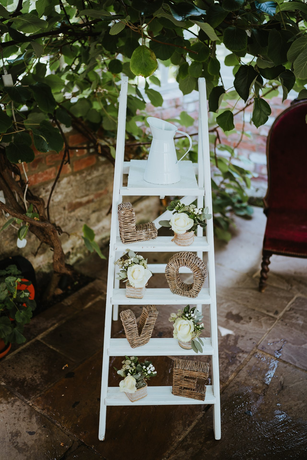 White ladder decorated for wedding