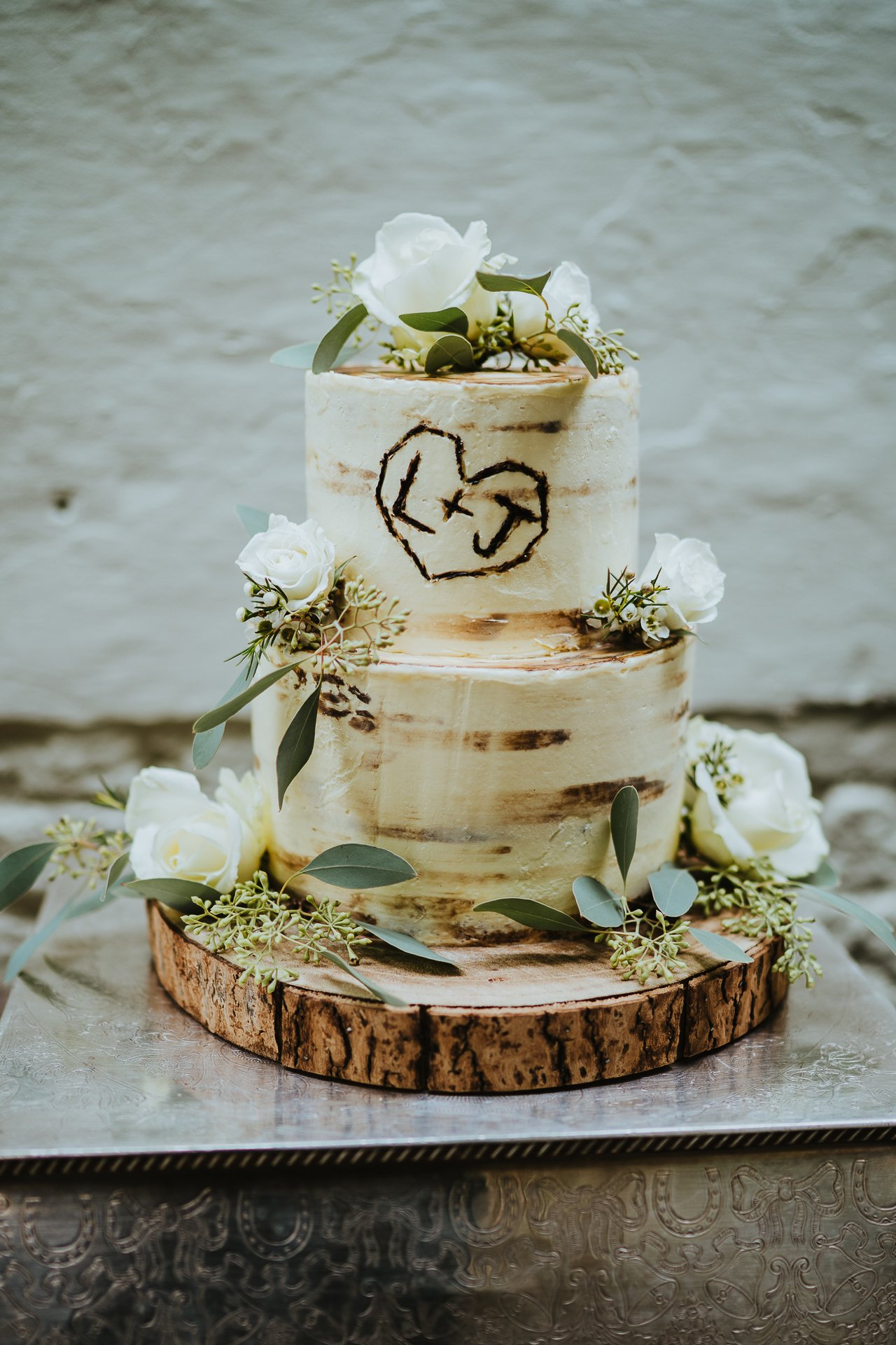 buttercream decorated wood styled wedding cake