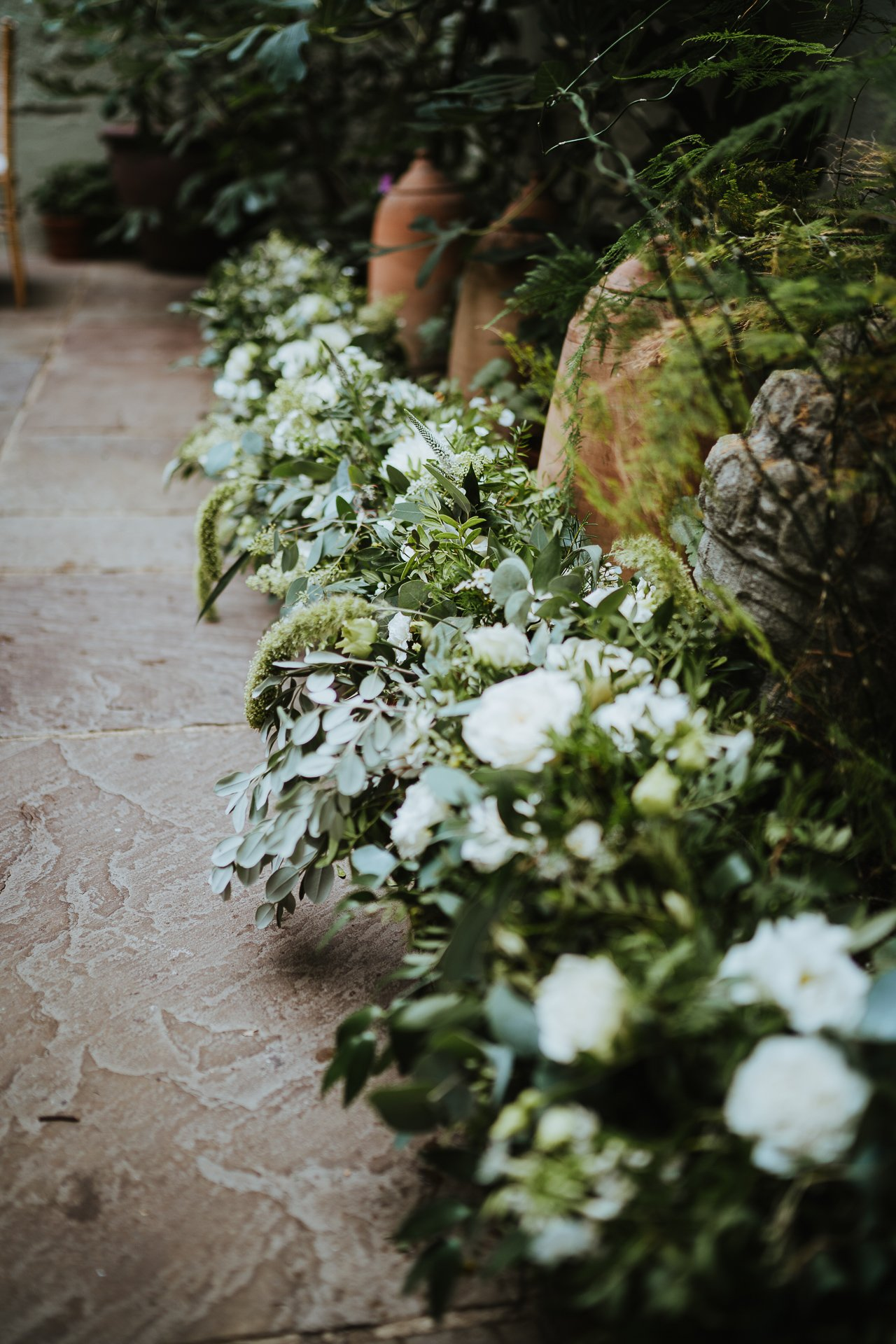 Beautiful white flowers with green foliage to decorate the reception venue