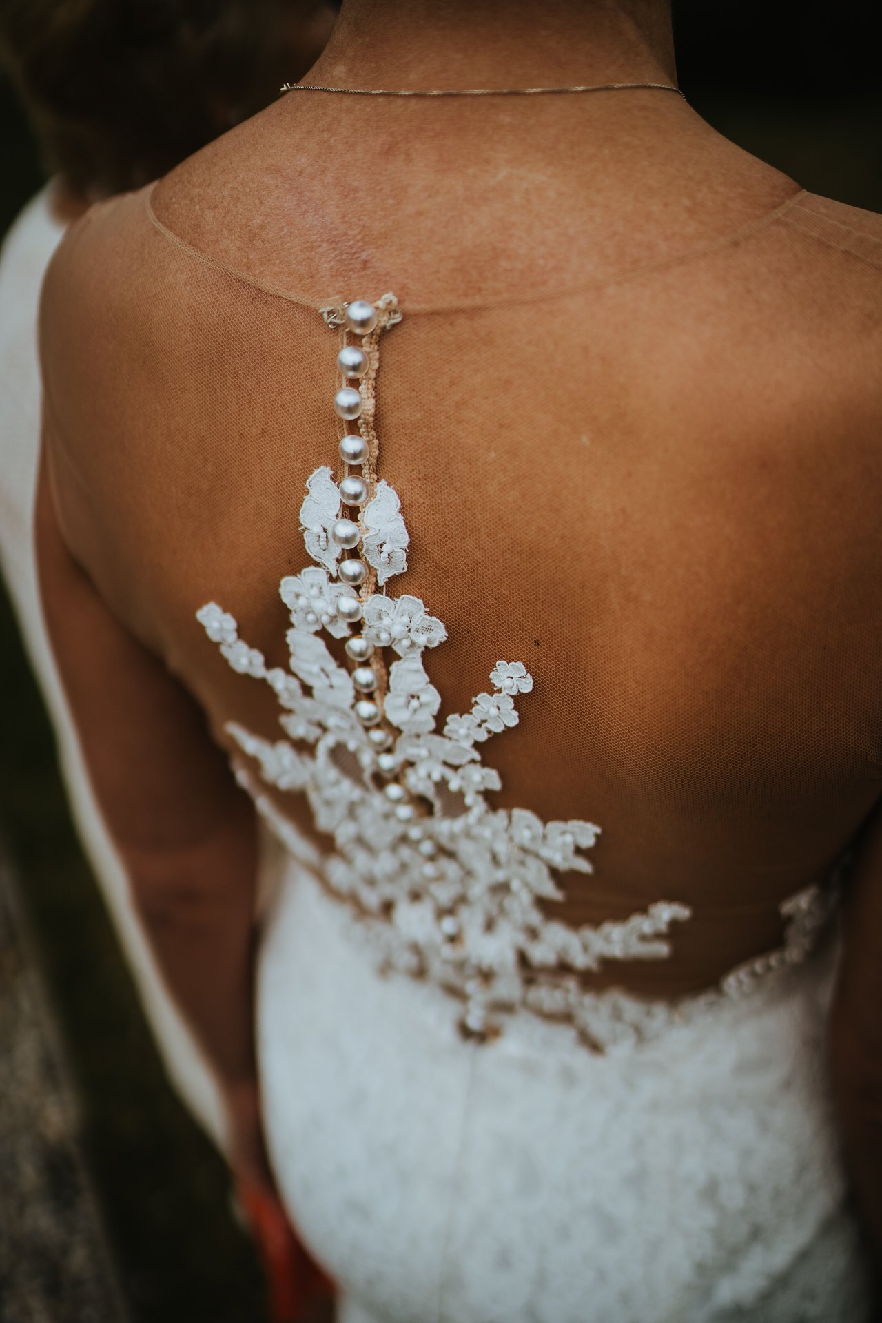close up of gorgeous back detail on the wedding dress