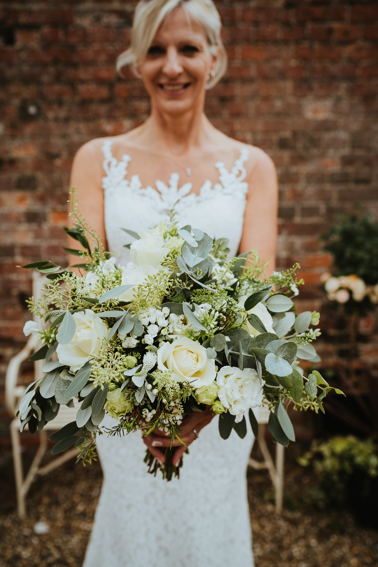 Bride holding her gorgeously textured green and white bouquet