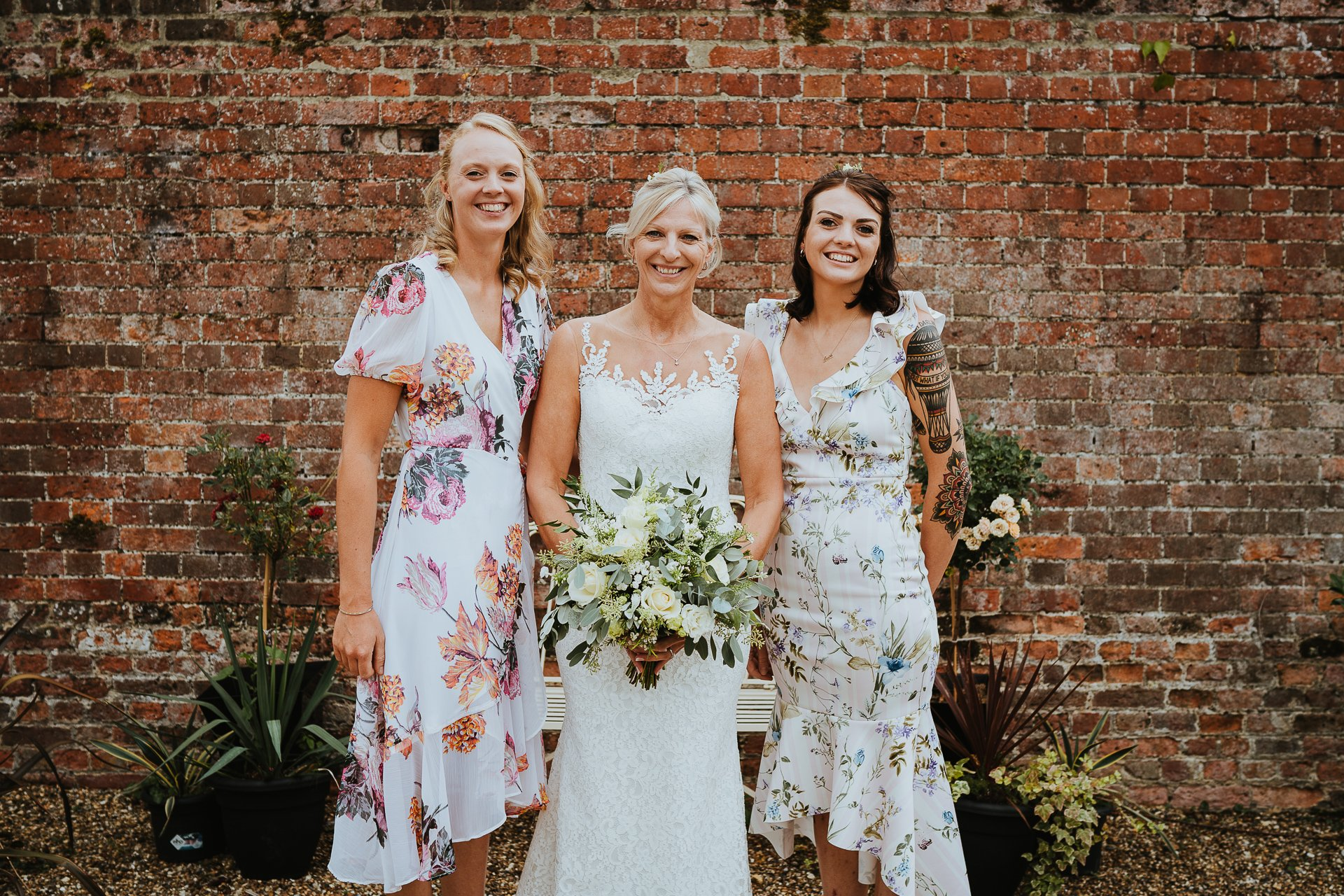 Smiling bride and her two daughters before her ceremony