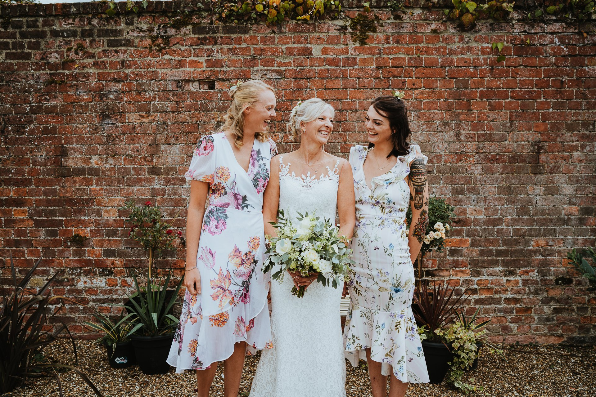 laughing bride and her two daughters before her ceremony
