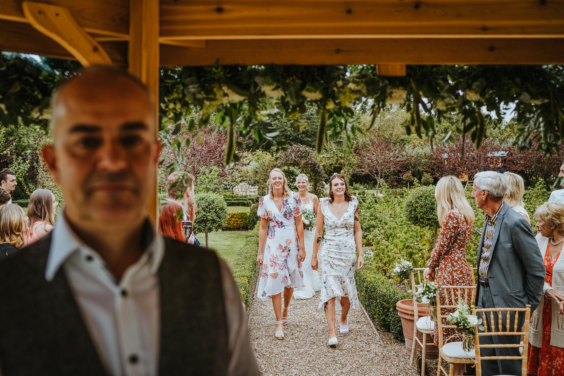 Daughters walk the bride down the aisle at The secret Garden Kent
