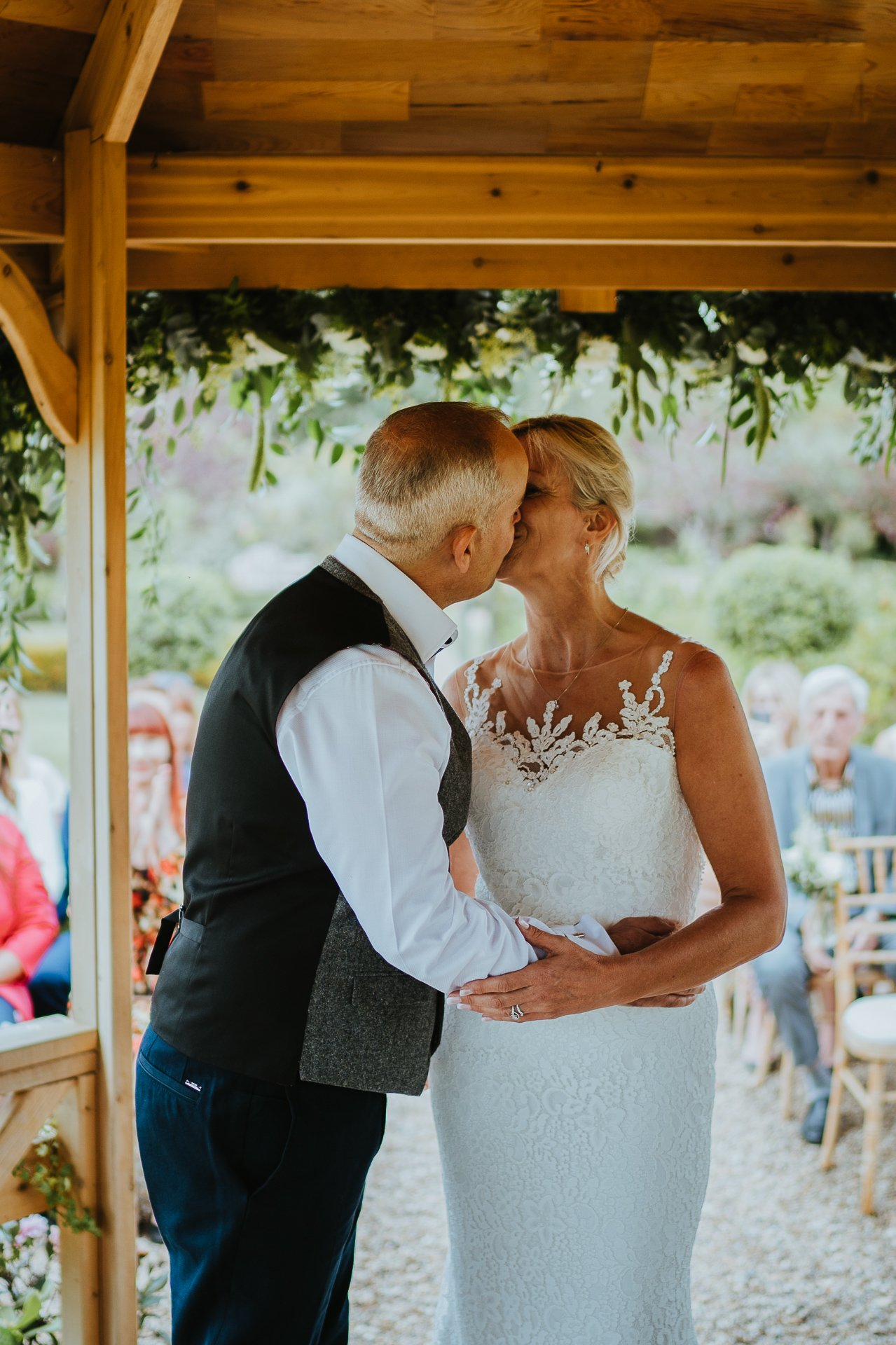 Bride and Groom first kiss at The Secret Garden Wedding venue