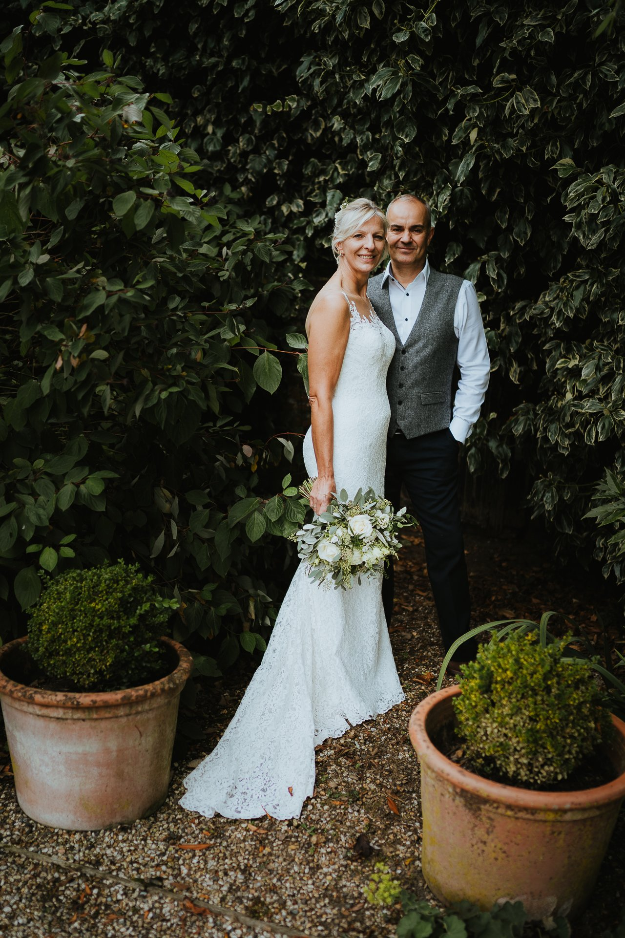 Bride and groom in garden portrait