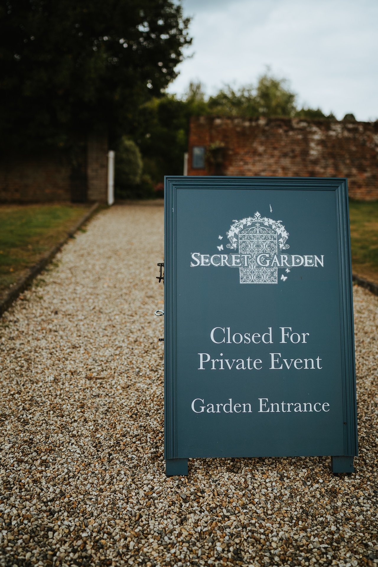 Closed Secret Garden sign for wedding ceremony