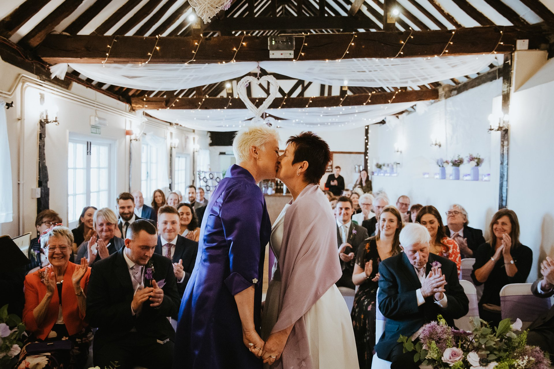 Two Brides during their first kiss at Weddings at The Bull Hotel Kent
