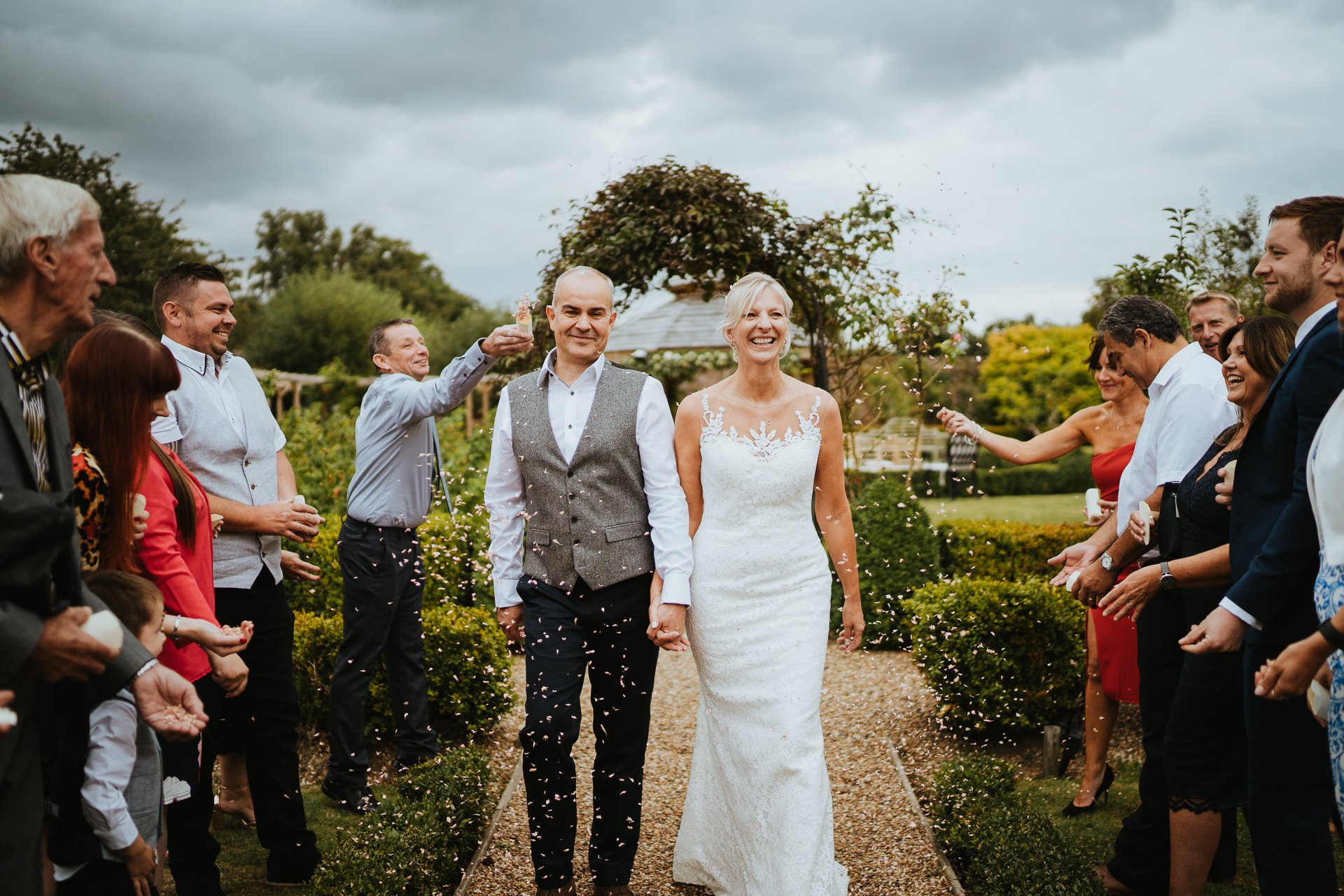 Bride and Groom showered with confetti during their Secret Garden wedding