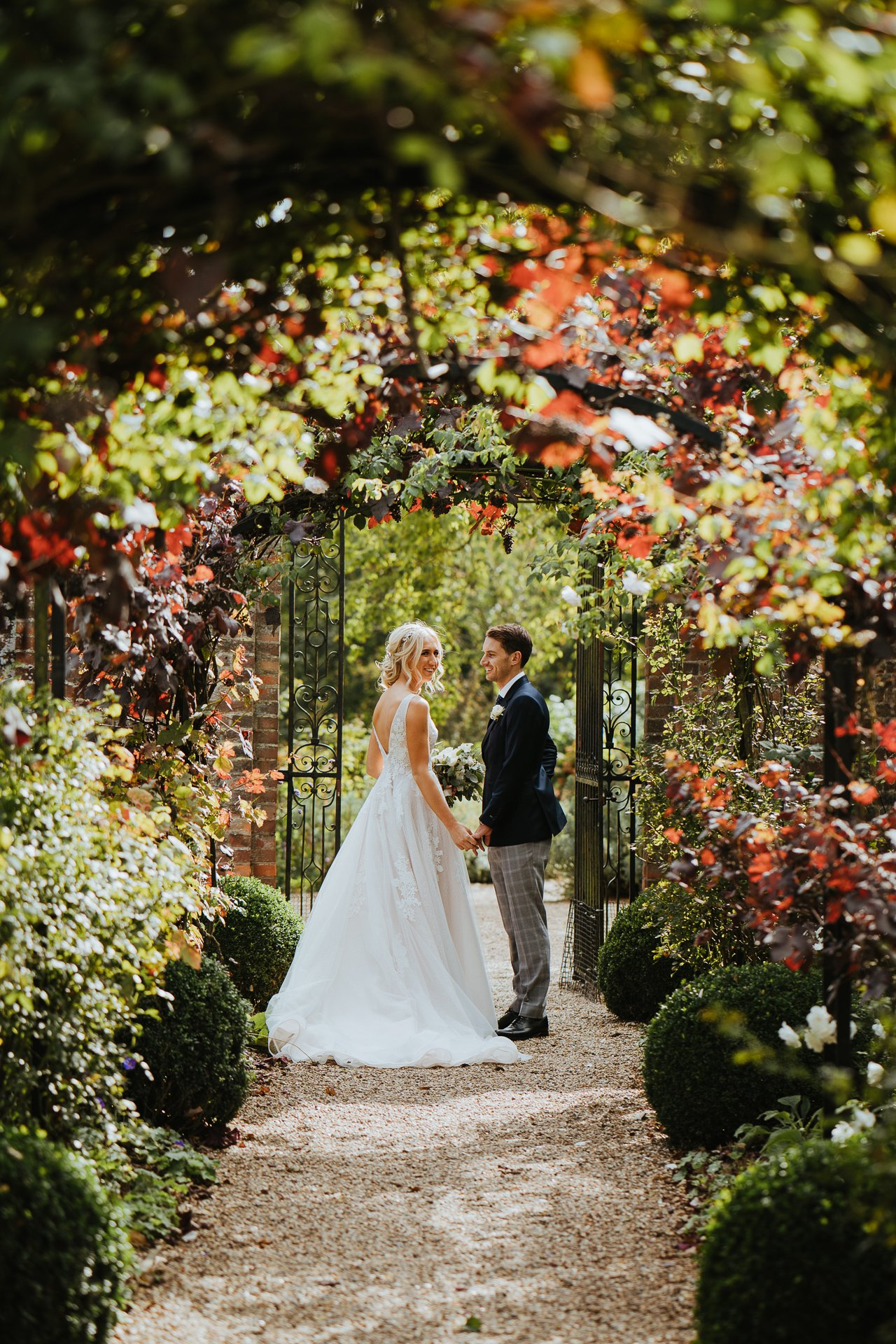 Bride and Groom together under leaf arch