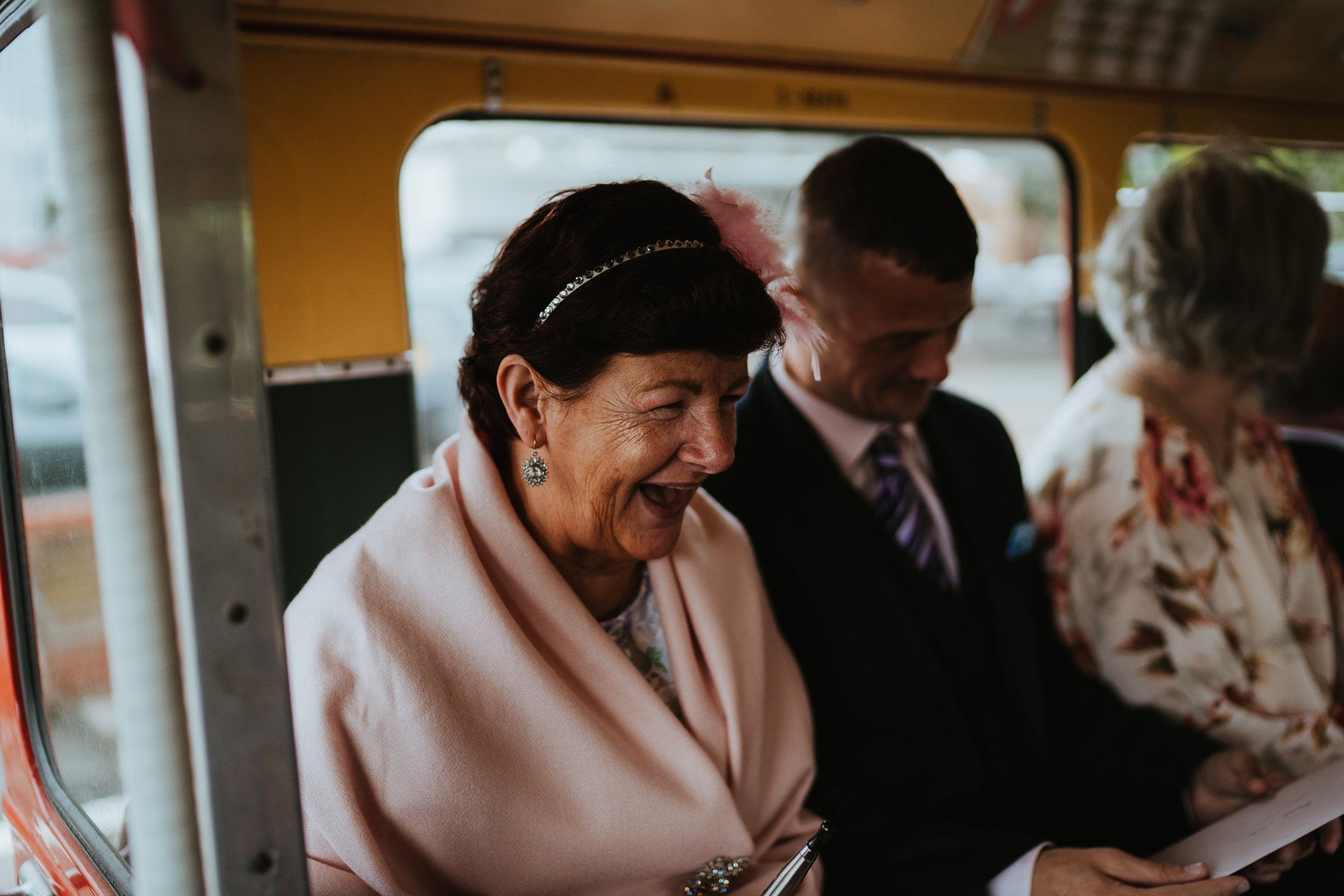 Wedding guest laughing on Route Master bus