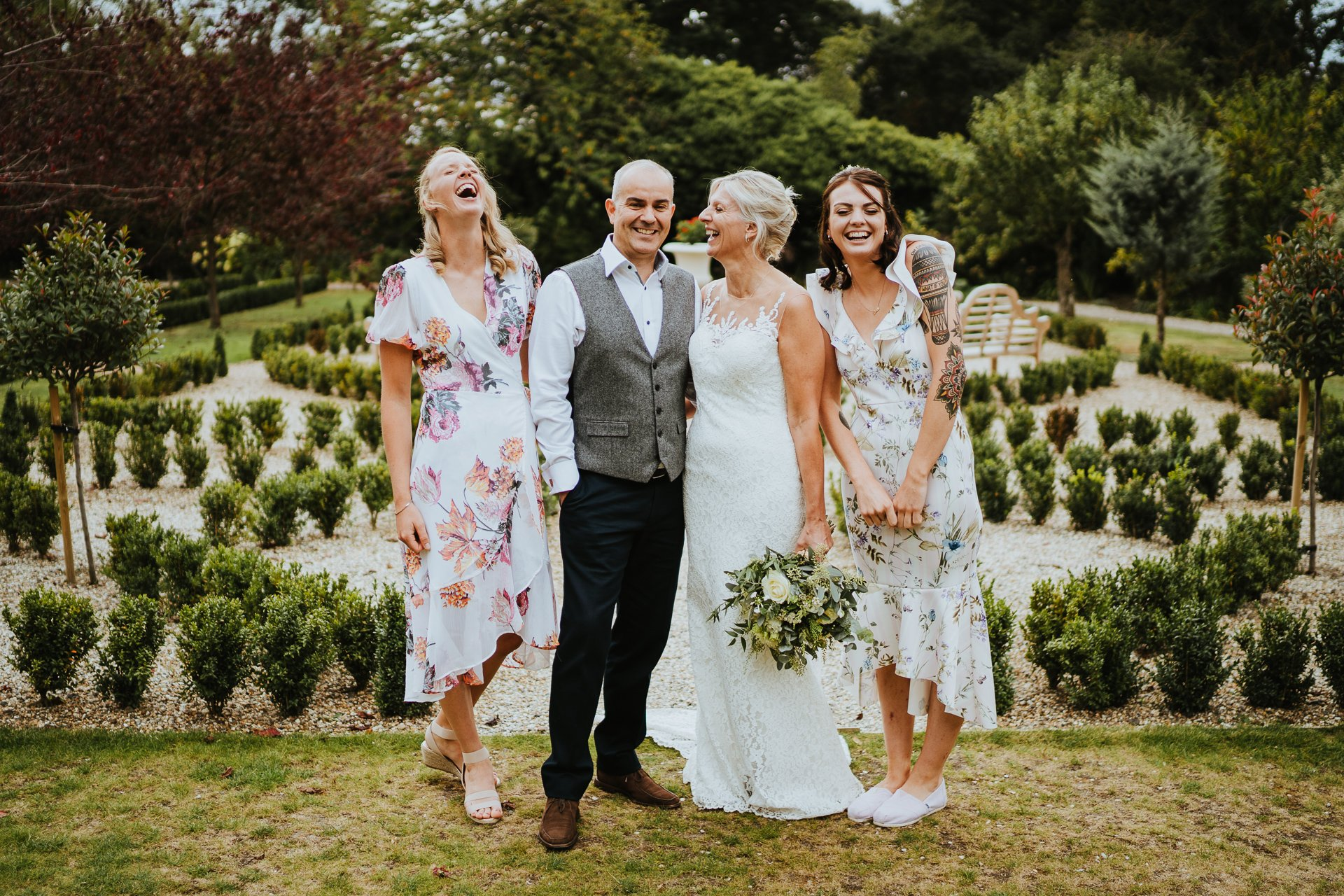 Bridal party laughing together at Secret Garden Wedding