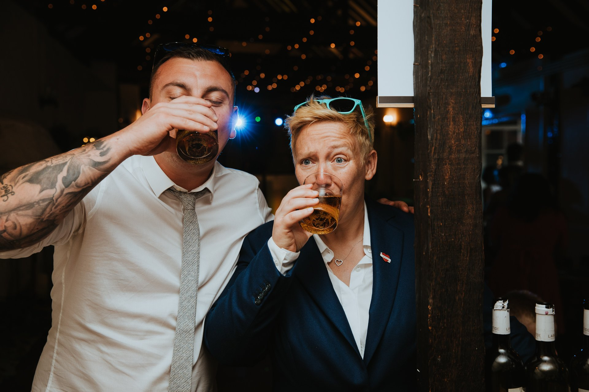 Wedding guests drinking during reception