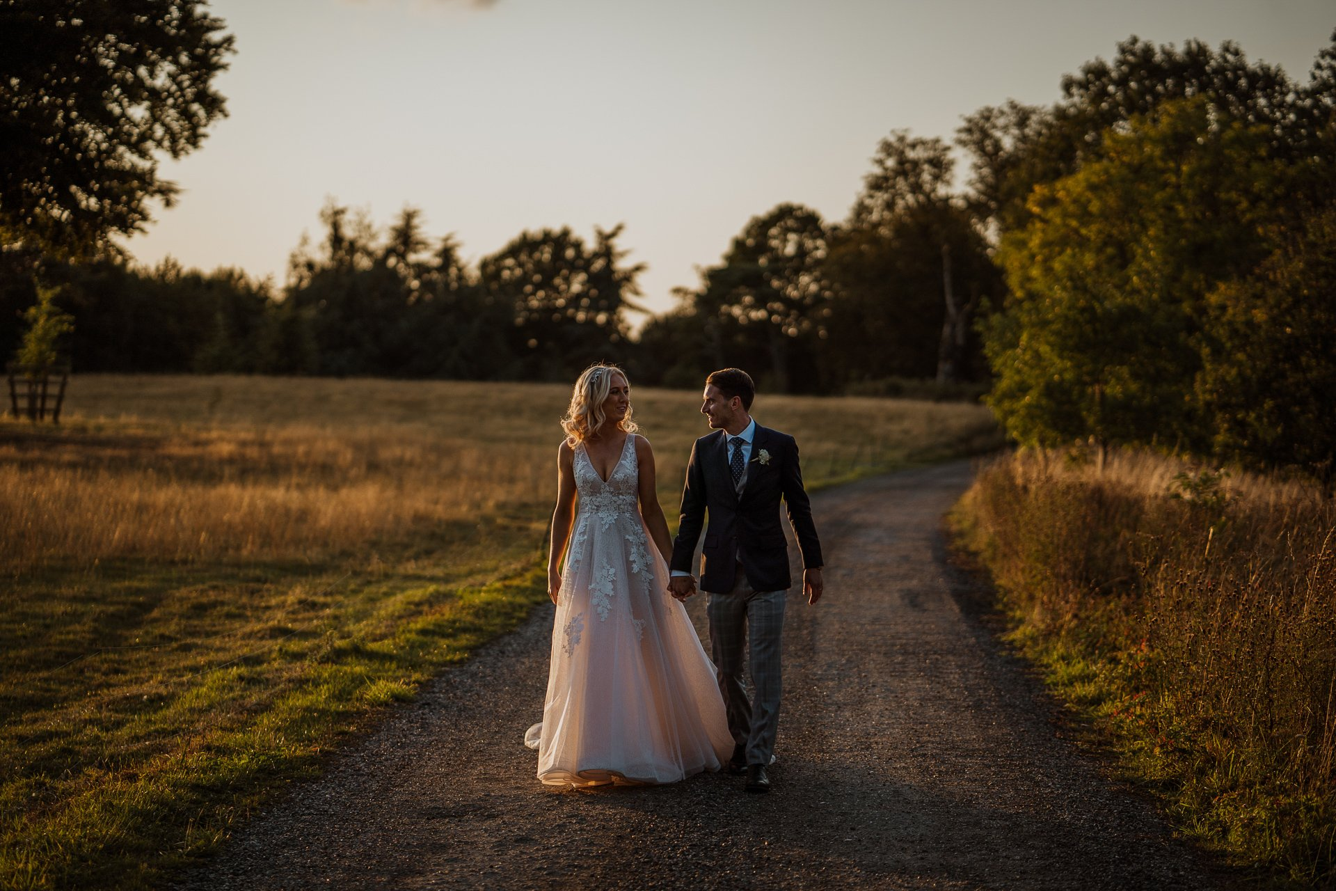 Bride and Groom walking together after their wedding at sunset
