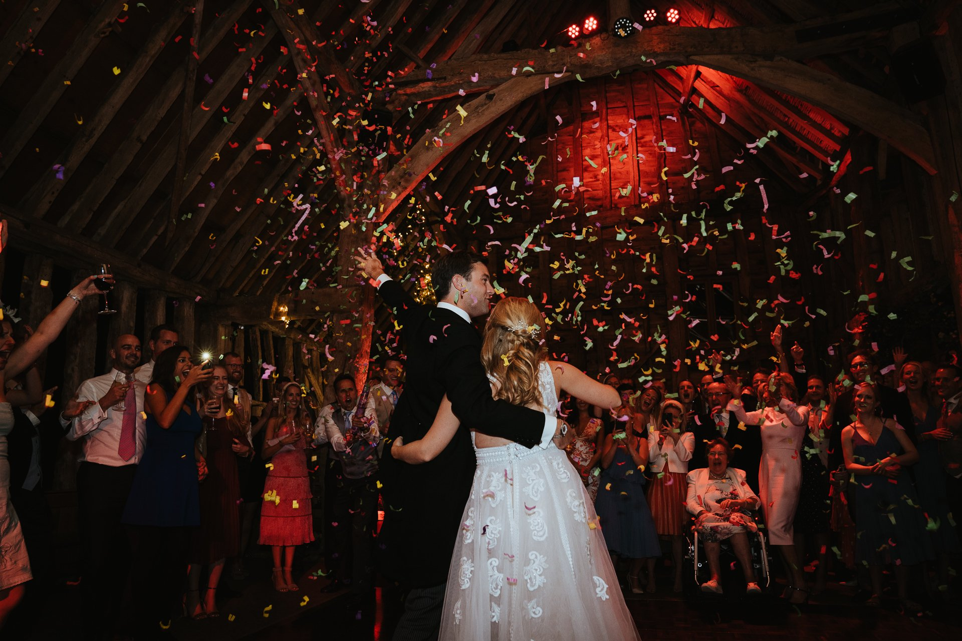 Bride and Groom showered with confetti canon
