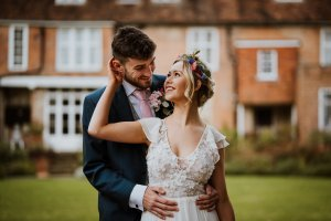 Bride and Groom looking at each other smiling in Country Garden Wedding in Kent