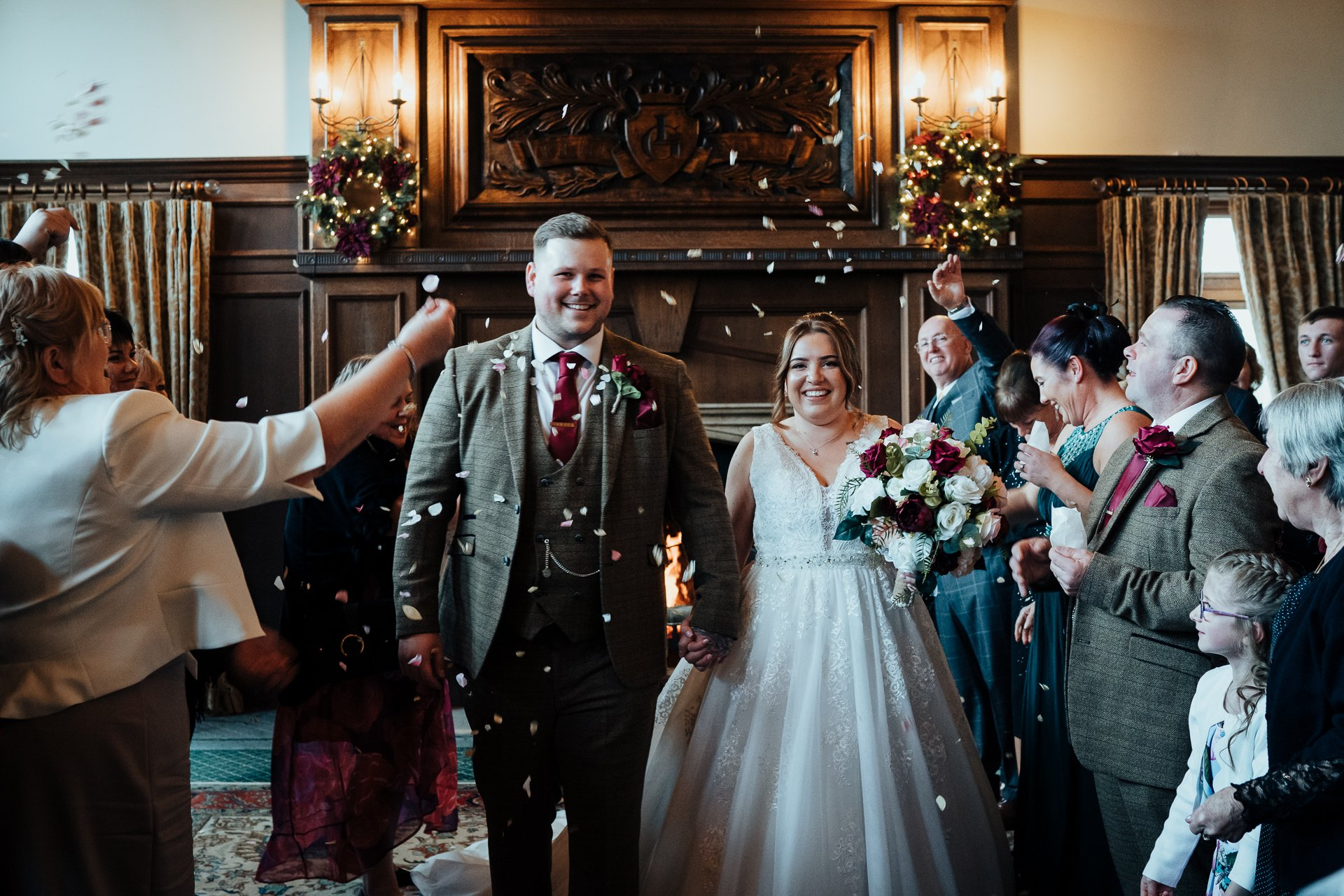 Bride and Groom showered with confetti in the Great Hall at The London Golf Club Kent