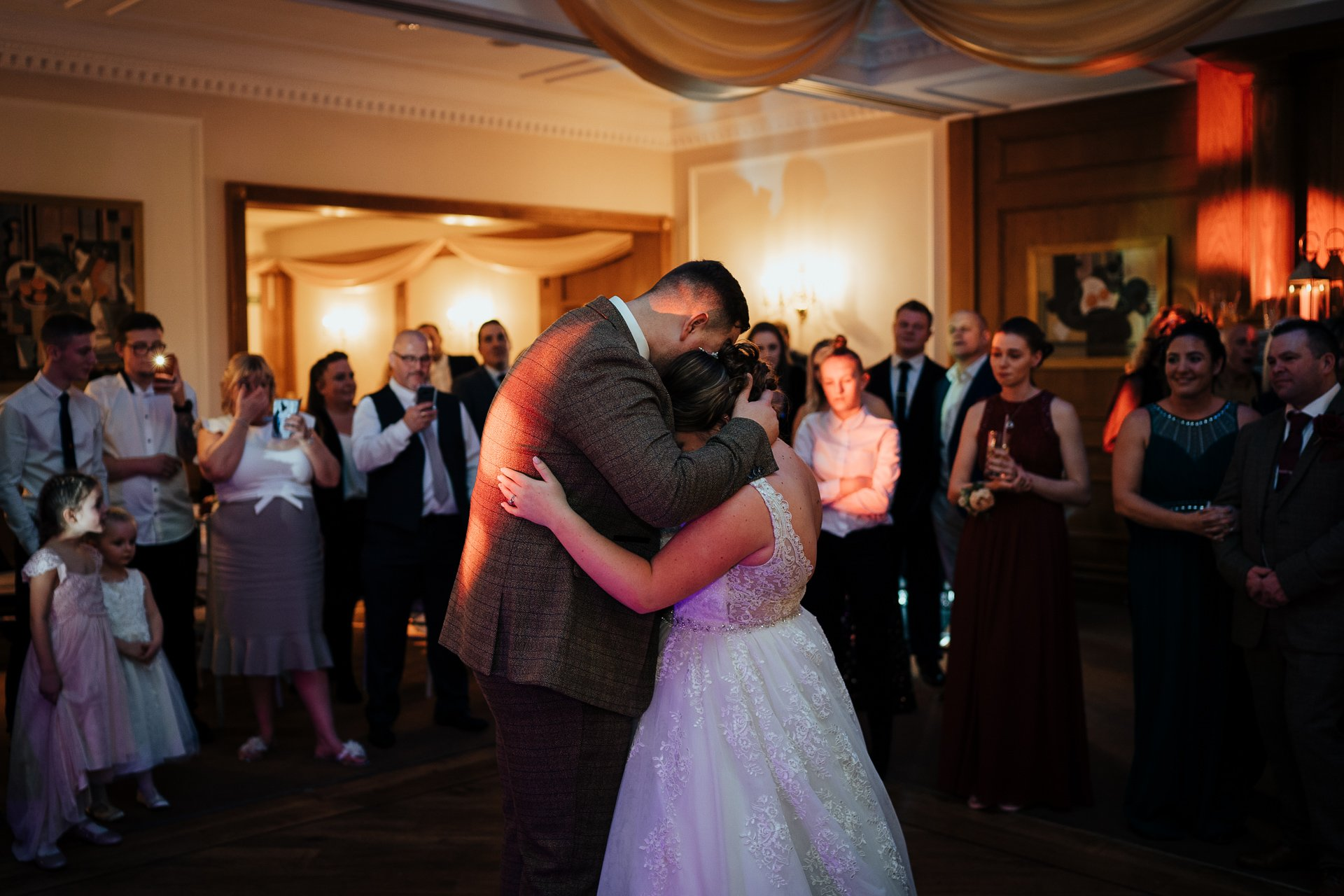 Bride and Groom holding each other crying during their first dance