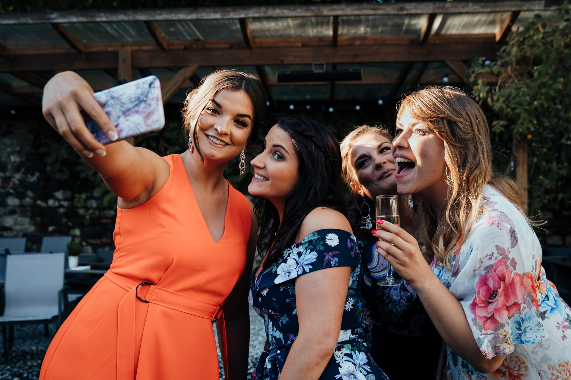 Wedding guests take a selfie with their mobile phone
