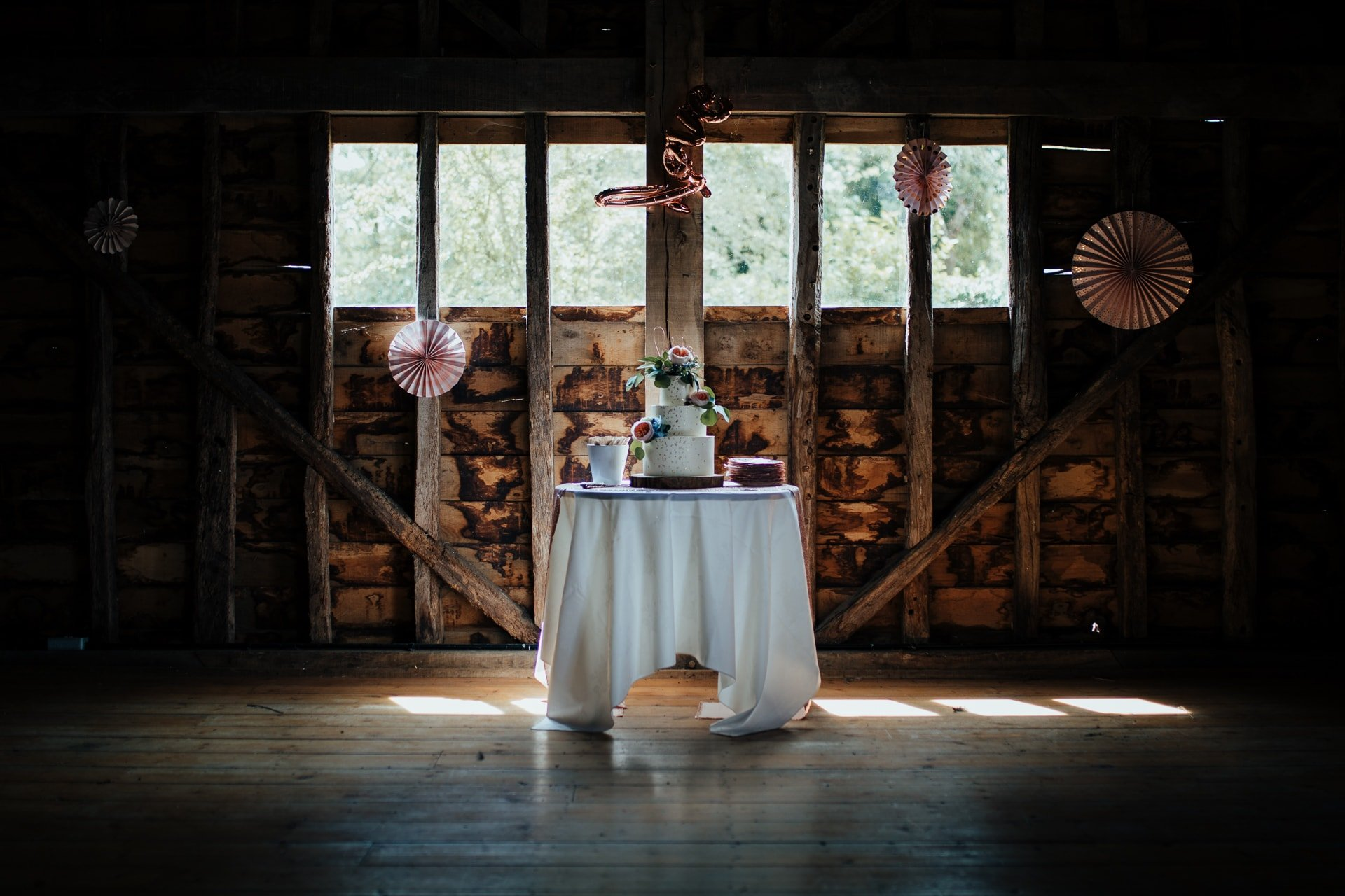 wedding cake in beautiful barn surrounding