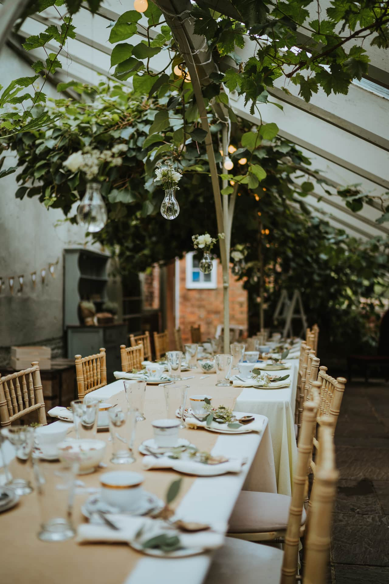 Wedding reception decoration in the Glass house at The Secret Garden wedding venue Kent