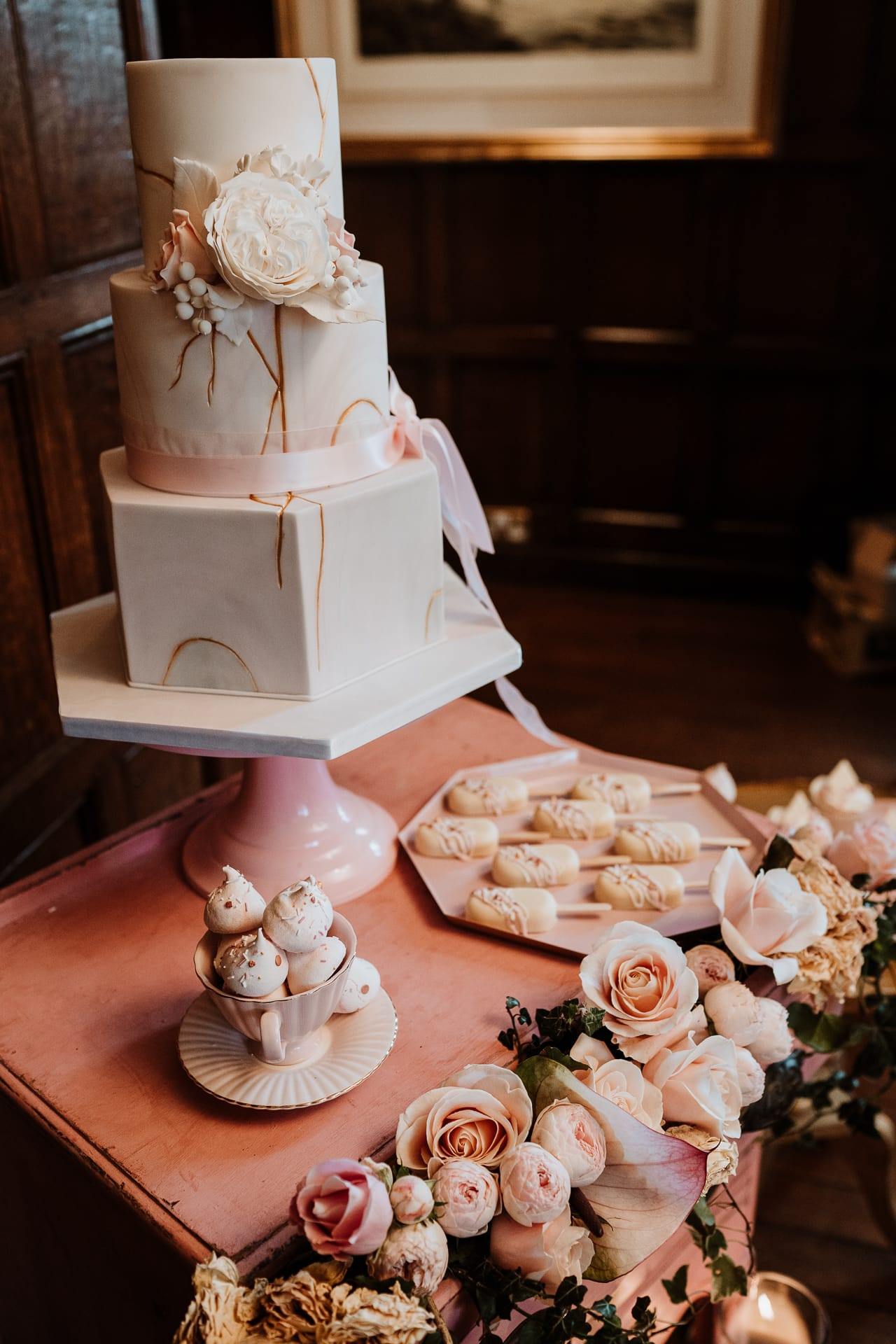 3 tier marbled cake on pink dessert table at Eastwell Manor