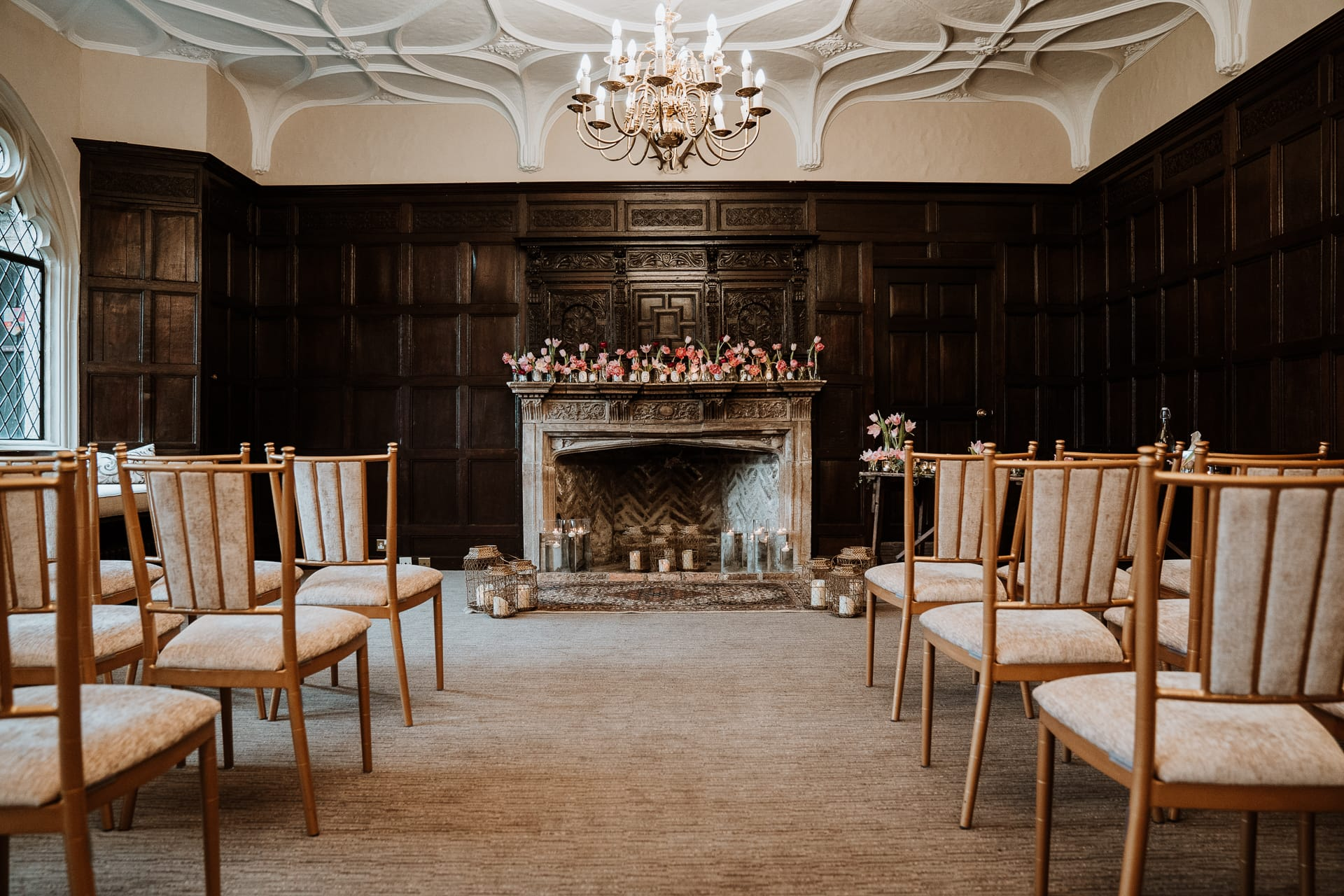 Grand fireplace in dark panel walled ceremony room at Eastwell Manor