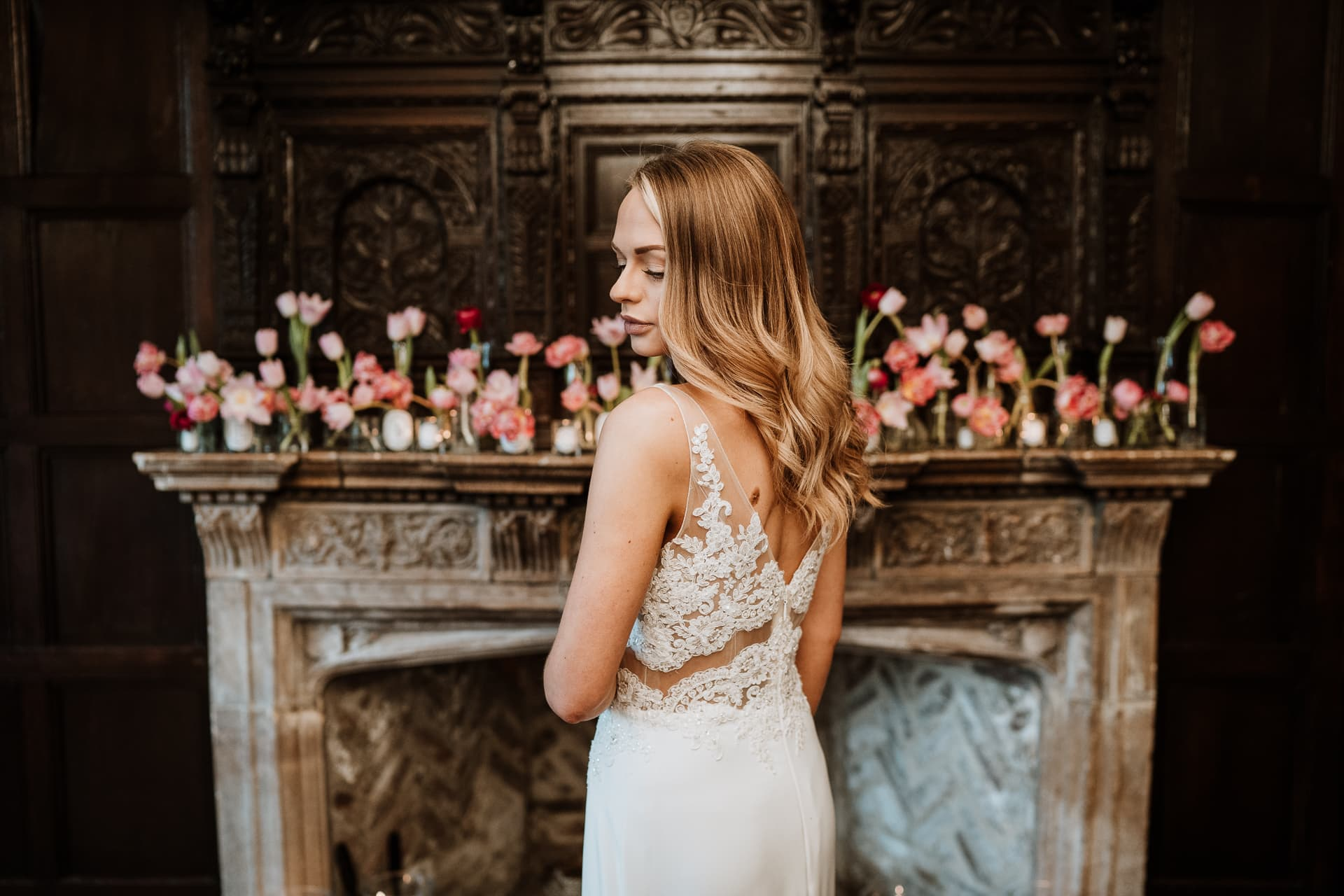Stunning Bride in front of Bishop of Bayeux fireplace at Eastwell Manor