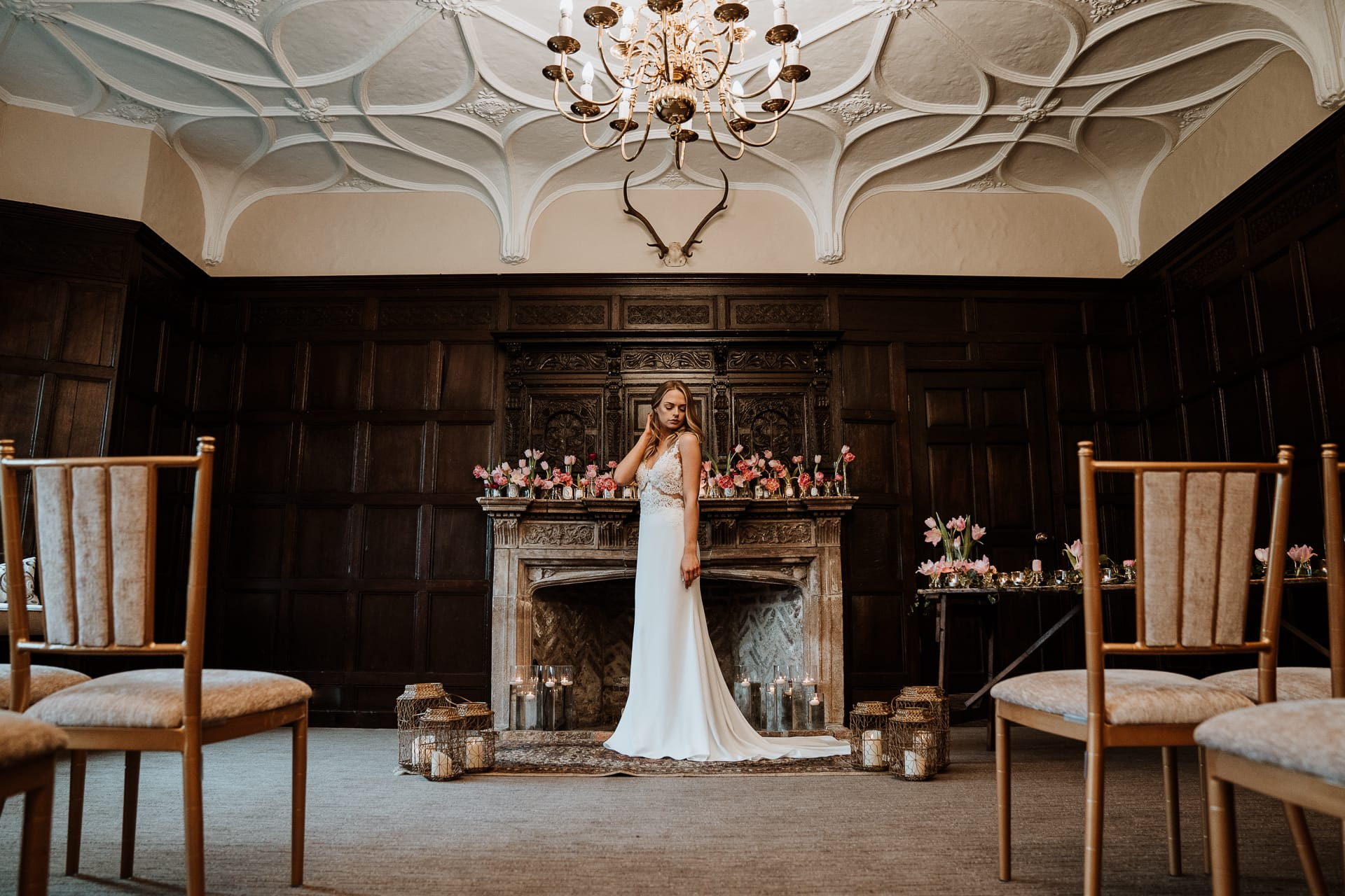 Bride in front of grand fireplace in Eastwell Manor Ceremony room