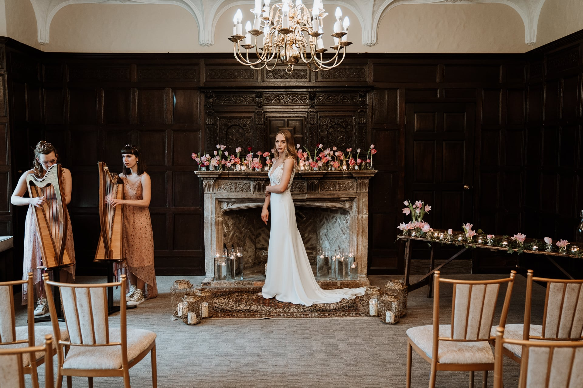 Stunning Bride in front of Bishop of Bayeux fireplace at Eastwell Manor with harpists