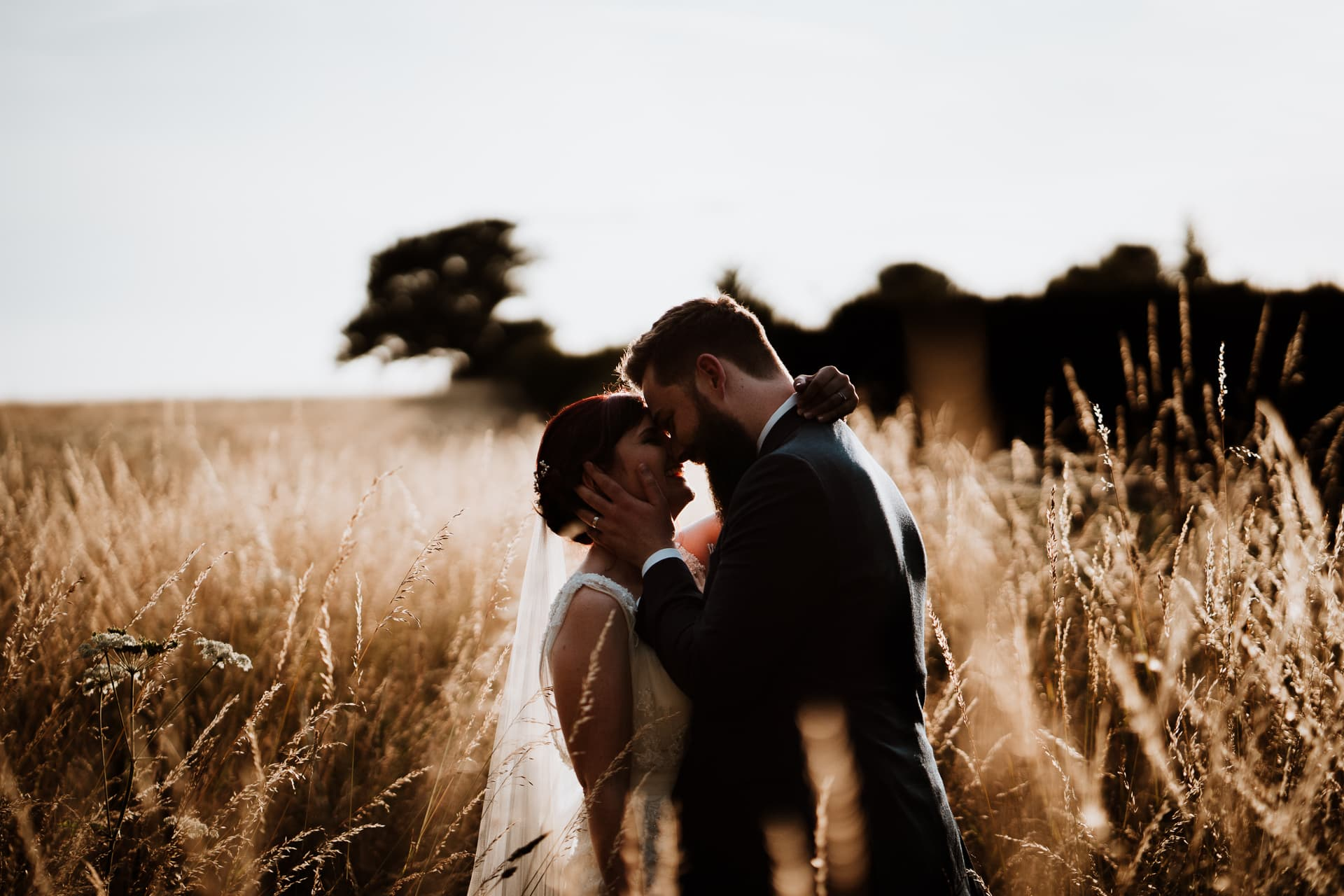 Bride and Groom kissing in golden hour portrait in Kent