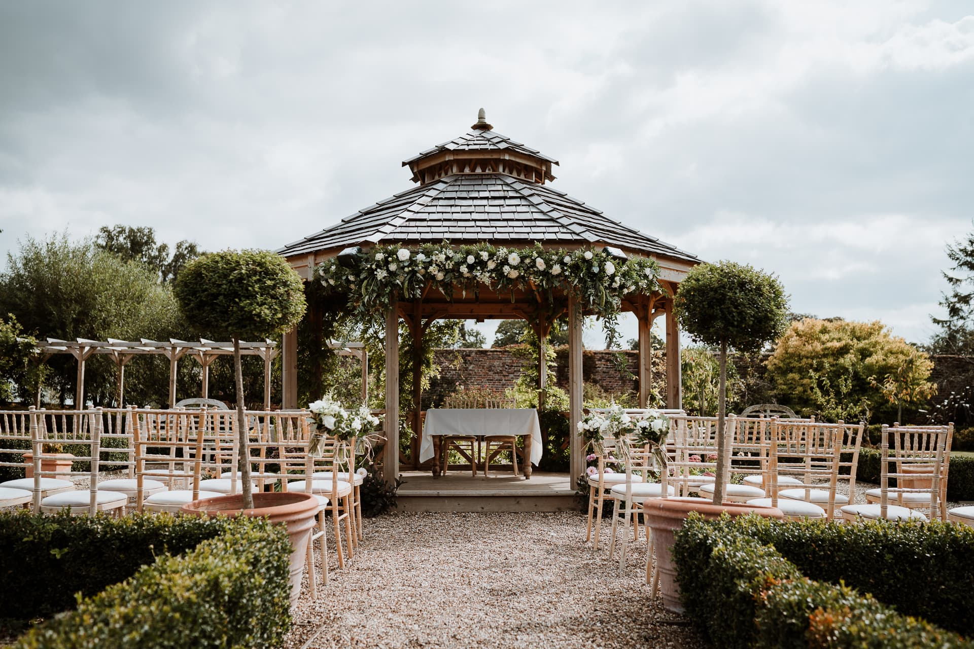 The Gazebo at The Secret Garden Wedding Venue decorated with green and white flowers for ceremony
