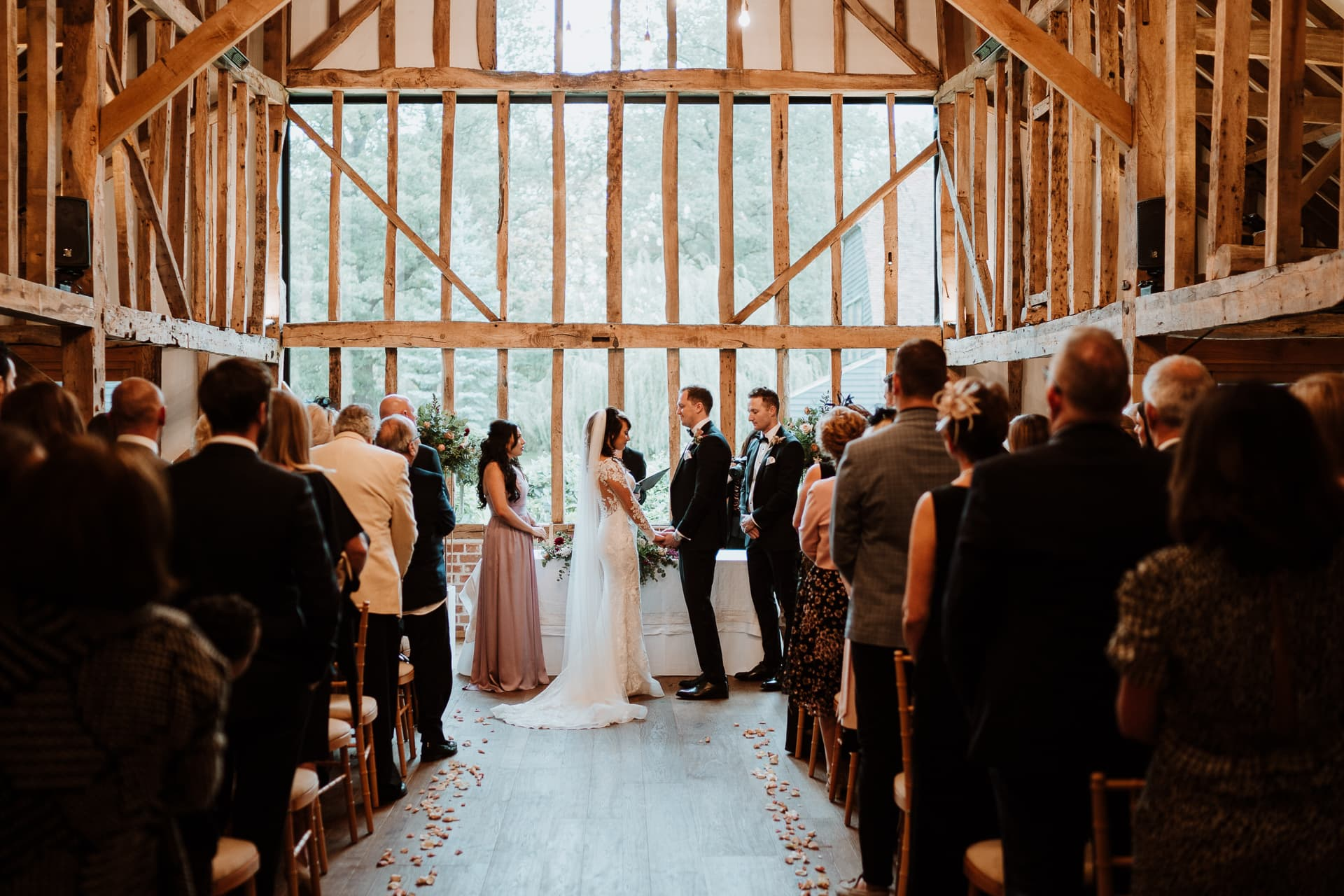 Bride and Groom hand in hand during their Barn Wedding
