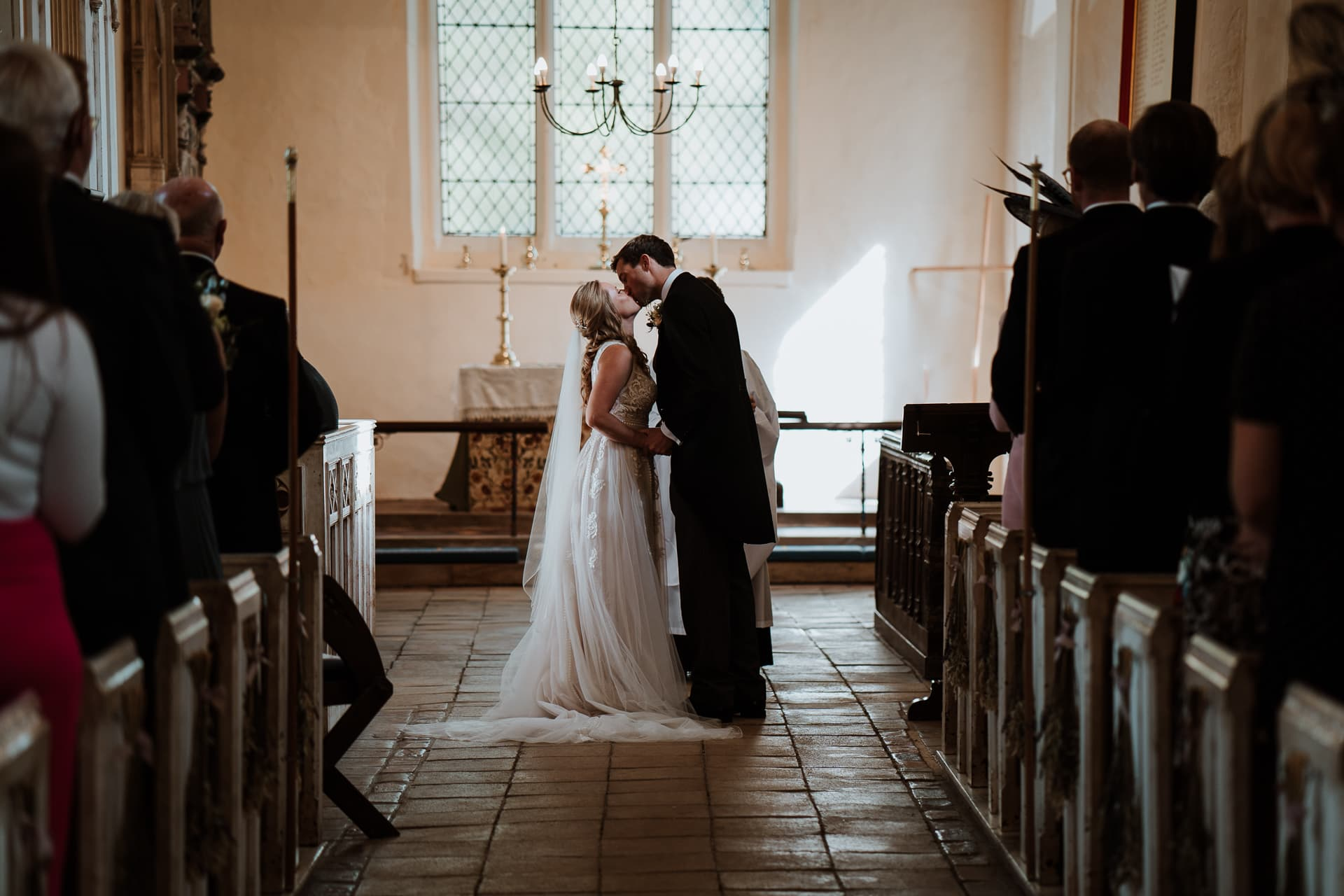 Bride and Groom kissing during their Church wedding ceremony