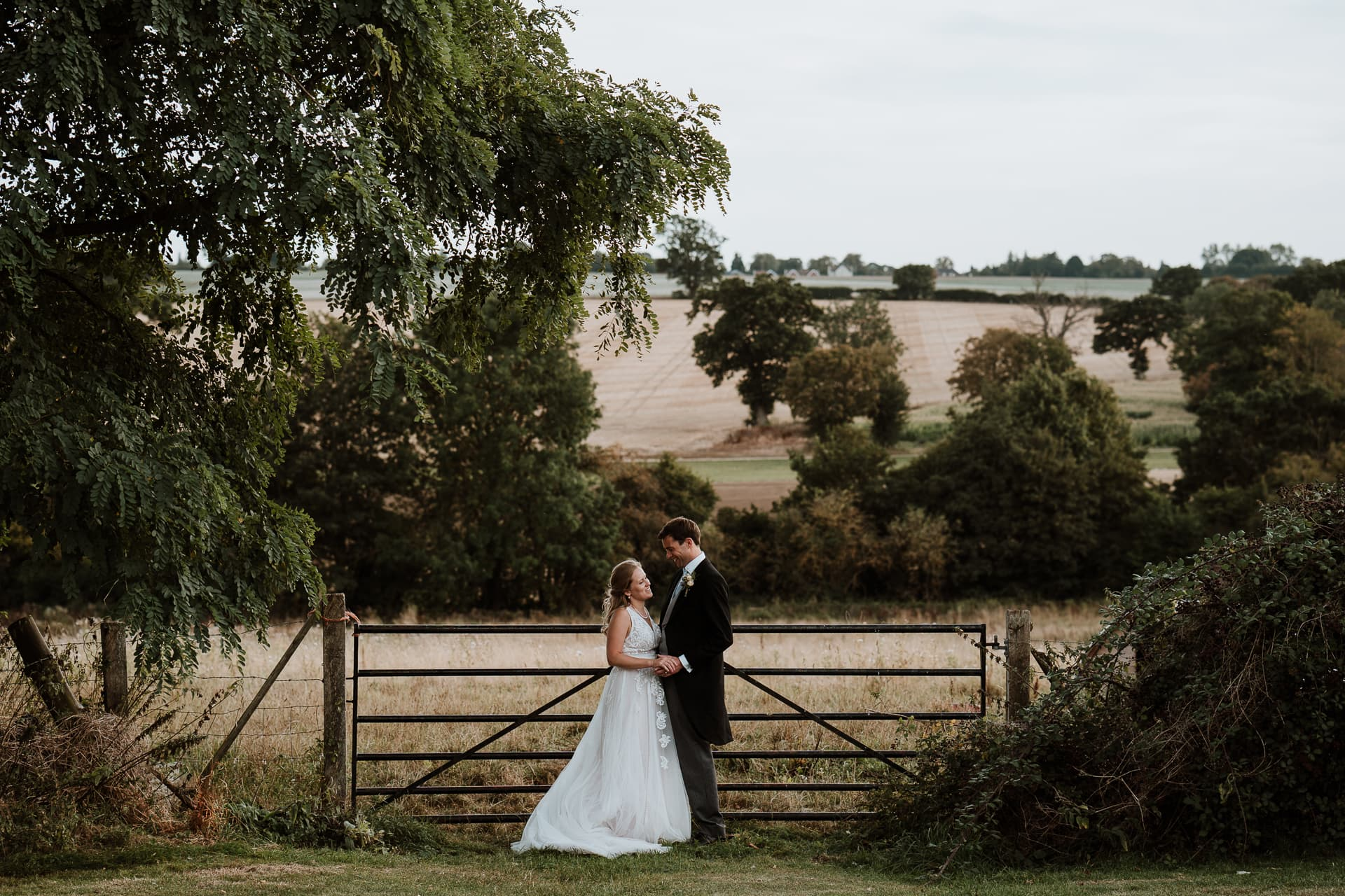 Bride and Groom at farm gate