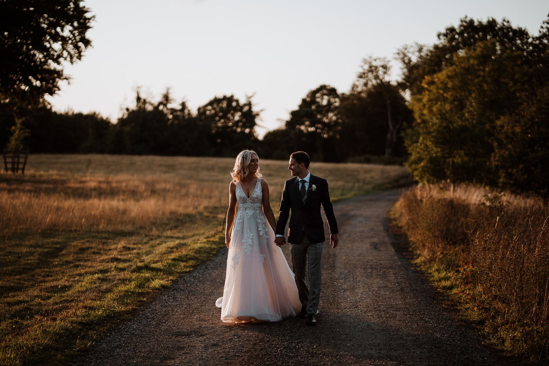 Bride and Groom walking together at sunset