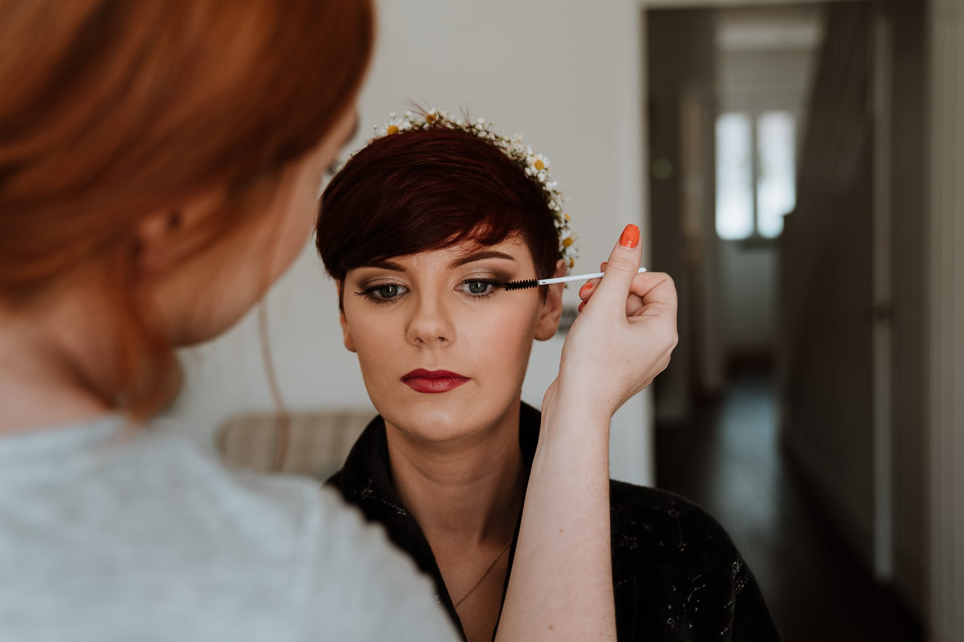 Bride with short hair having her bridal eye makeup applied